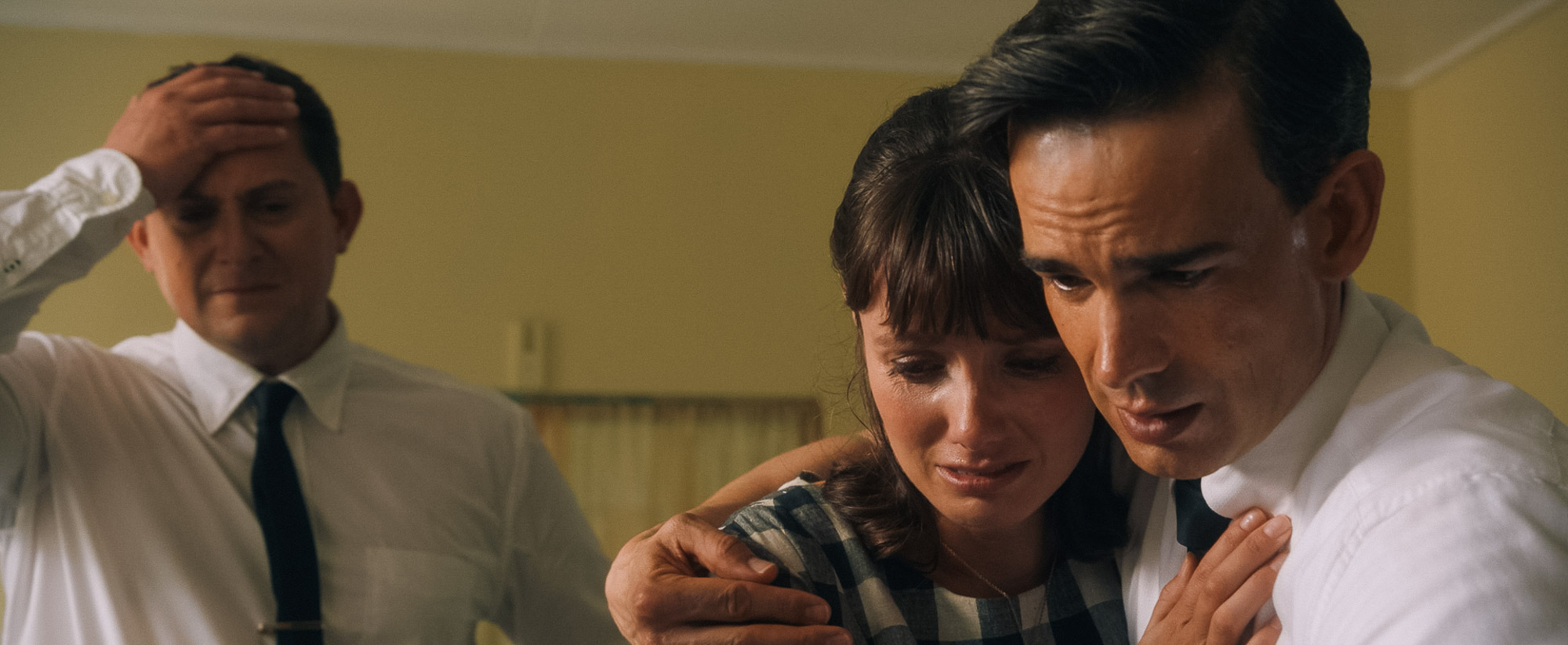 """Elder John H. Groberg (played by Christopher Gorham, right) and his wife, Jean (Natalie Medlock, center) worry for the health of their baby boy, in a scene from the movie """"The Other Side of Heaven 2: Fire of Faith."""" Russell Dixon, at left, portrays Thomas S. Monson, who would later become president and prophet of The Church of Jesus Christ of Latter-day Saints. (Photo courtesy Excel Entertainment.)"""