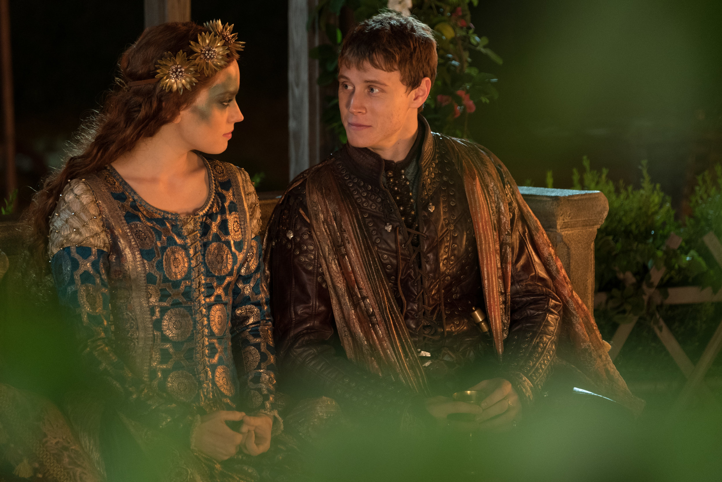 """Ophelia (Daisy Ridley, left) chats with Hamlet (George MacKay) at a masquerade dance, in a scene from Claire McCarthy's """"Ophelia."""" (Photo courtesy IFC Films.)"""