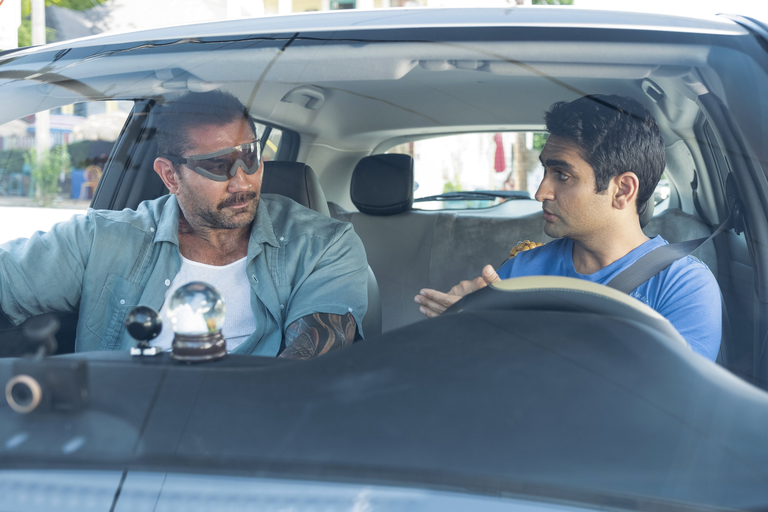 "Police detective Vic (Dave Bautista), left, employs an Uber driver, Stu (Kumail Nanjiani), to help crack a case in the buddy-cop comedy ""Stuber."" (Photo by Mark Hill, courtesy of 20th Century Fox.)"