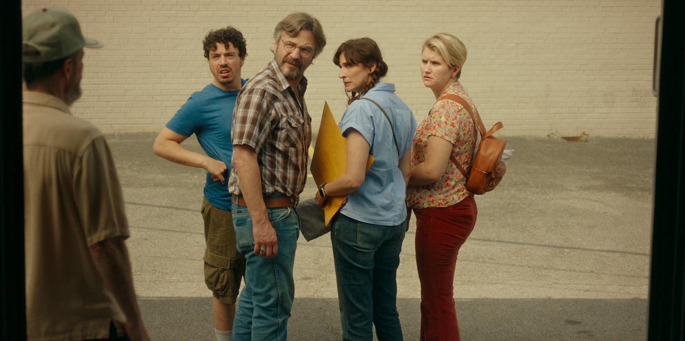 """Pawn-shop owner Mel (Marc Maron, center left) and his employee Nathaniel (Jon Bass, far left) strike a deal with Mary and Cynthia (Michaela Watkins and Jillian Bell) to sell a Civil War-era artifact in Lynn Shelton's comedy """"Sword of Trust."""" (Photo courtesy of IFC Films.)"""