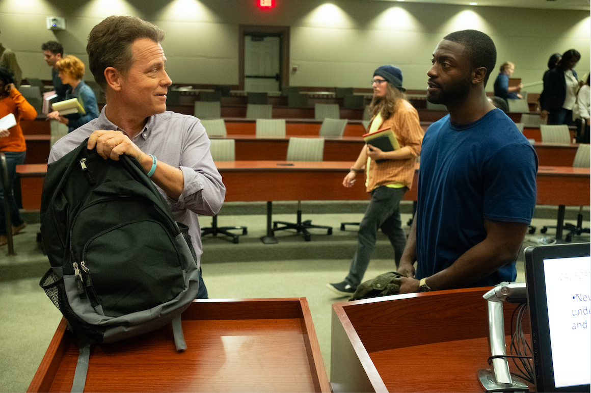 """Brian Banks (Aldis Hodge, right) talks to Justin Brooks (Greg Kinnear), the attorney who founded the California Innocence Project, about his case, in a scene from the drama """"Brian Banks."""" (Photo by Katherine Bomboy, courtesy Bleecker Street Films.)"""