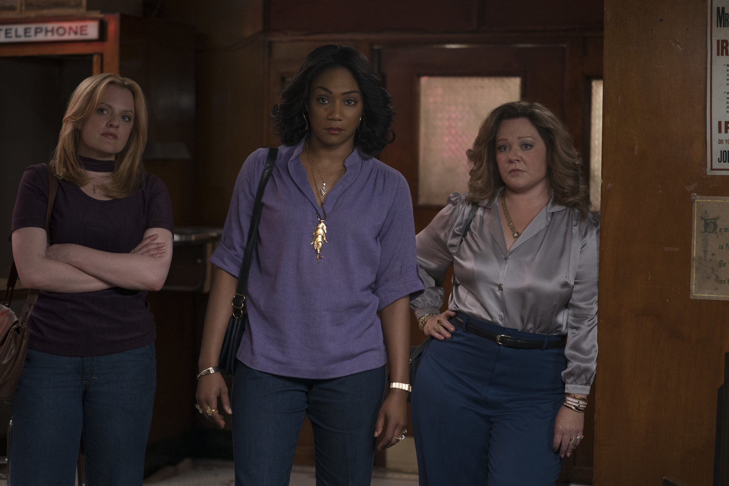 "Mob wives Claire (Elisabeth Moss), Ruby (Tiffany Haddish) and Kathy (Melissa McCarthy), from left, take over the business in their Hell's Kitchen neighborhood, in ""The Kitchen."" (Photo by Alison Cohen Rosa, courtesy of Warner Bros. Pictures.)"