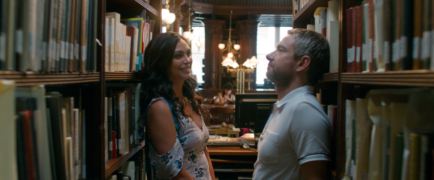 "Francesca (Morena Baccarin, left)  tries to draw Charlie (Martin Freeman) out of his shell, not knowing that too much happiness can hurt him, in a scene from the romantic comedy ""Ode to Joy."" (Photo courtesy of IFC Films.)"