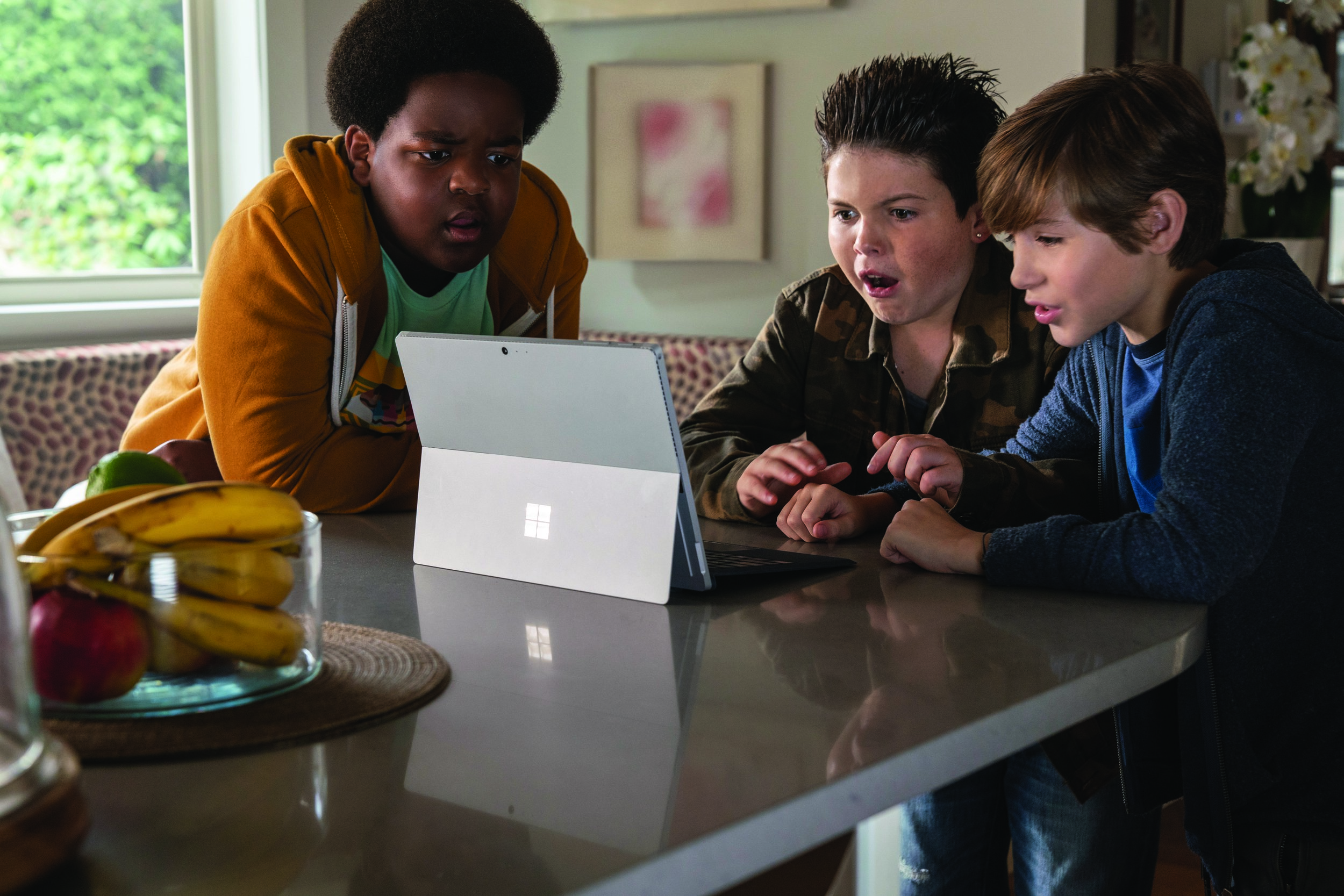 "Lucas (Keith L. Williams), Thor (Brady Noon) and Max (Jacob Tremblay), from left, try to learn about kissing from the internet, in the comedy ""Good Boys."" (Photo by Ed Araquel, courtesy of Universal Pictures.)"