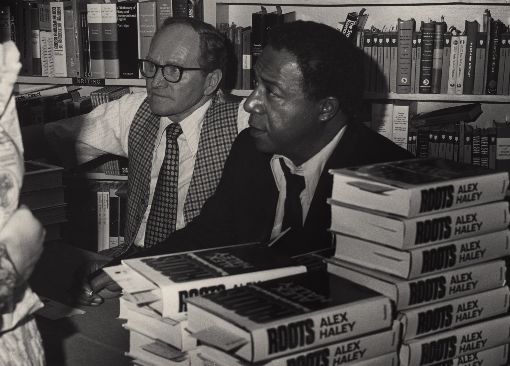 "Bookstore owner Sam Weller sits with author Alex Haley, at a signing event for Haley's bestseller ""Roots,"" in 1976. (Photo courtesy of The Salt Lake Tribune archives.)"