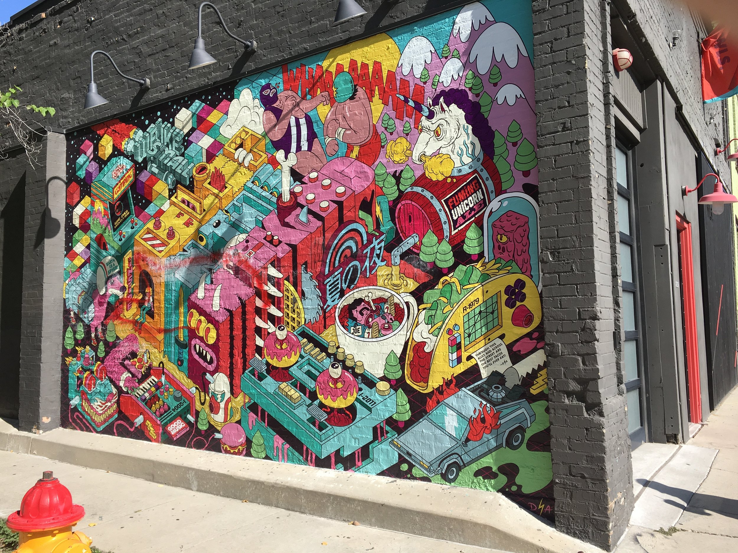 "Dave Arcade's mural ""Belief in the Making,"" on the side of the Welikesmall design firm's building, is one of many murals that have sprung up in and around Salt Lake City in recent years. (Photo by Sean P. Means 