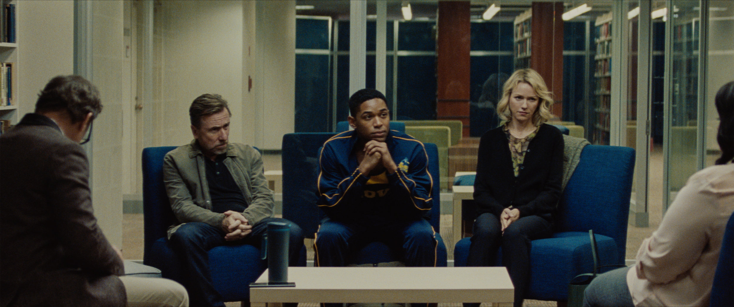 "An all-star athlete (Kelvin Harrison Jr., center) and his parents (Tim Roth and Naomi Watts) are called in after an alarming discovery is made about the student, in ""Luce,"" directed by Julius Onah. (Photo by (Larkin Seiple, courtesy of Neon Films.)"