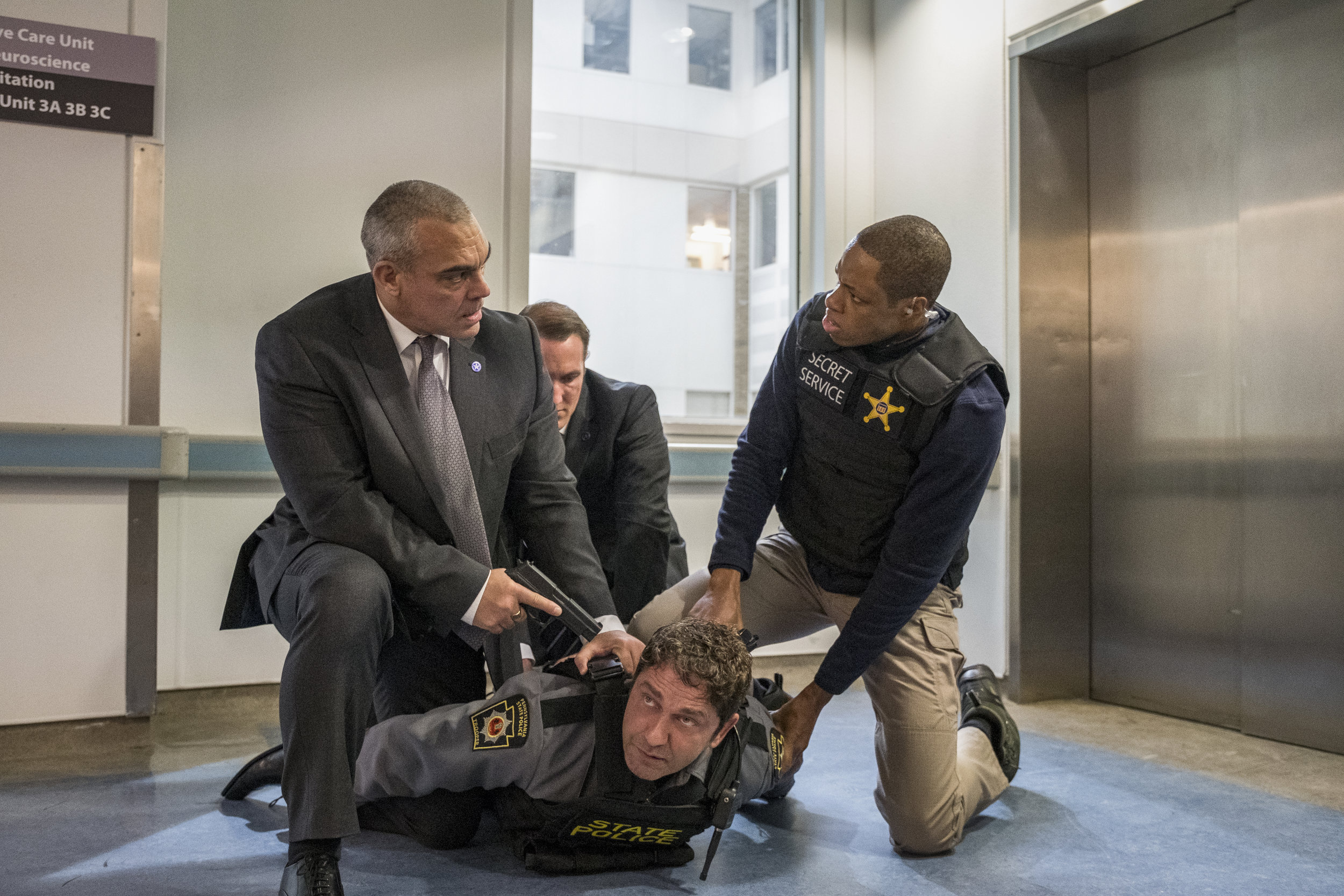 "Secret Service agent-turned-fugitive Mike Banning (Gerard Butler, bottom) is arrested by his former colleagues, in a scene from the action movie ""Angel Has Fallen."" (Photo by Jack English, courtesy of Lionsgate.)"