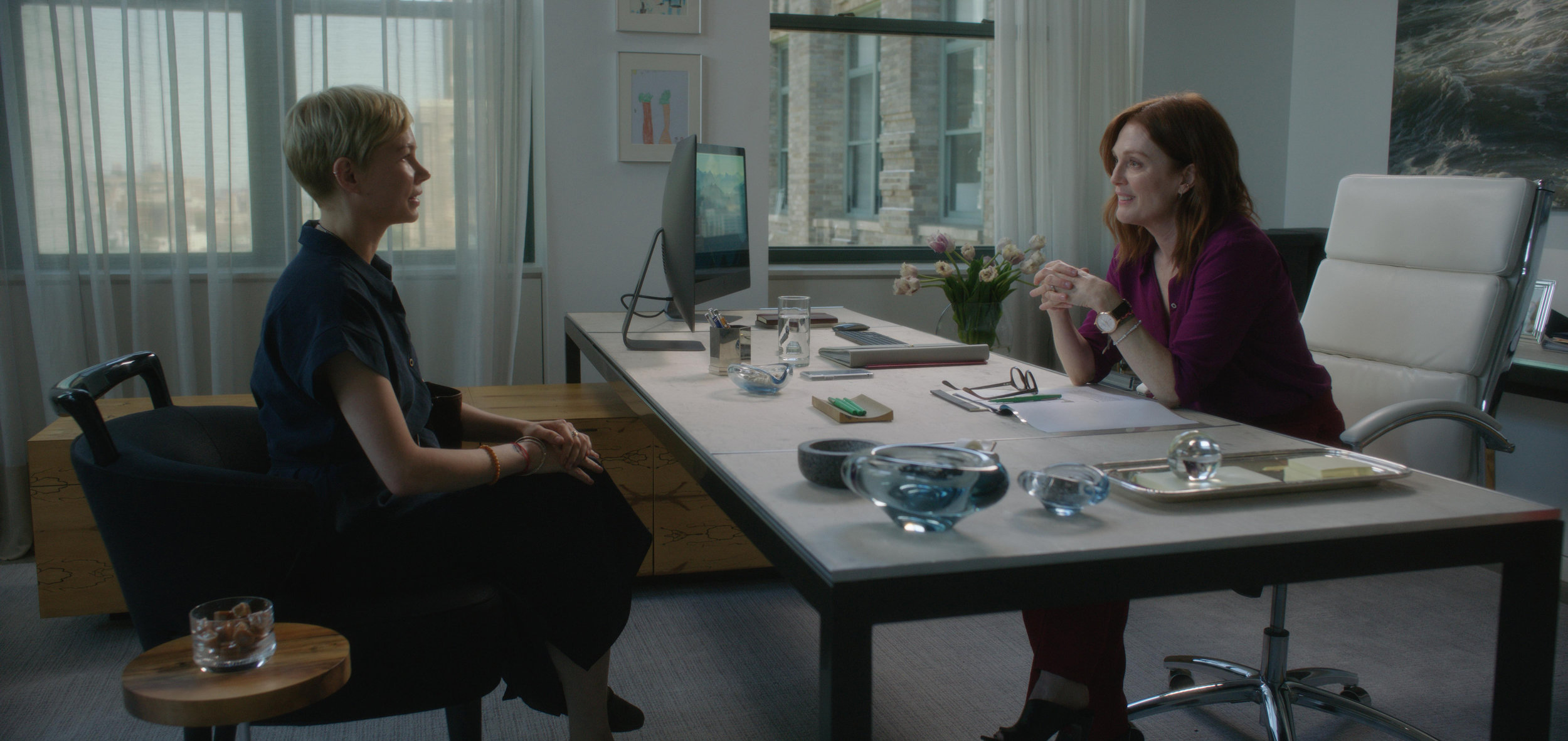 "Isabel (Michelle Williams, left) asks tech executive Theresa (Julianne Moore) for money to run a school in India, in a scene from the drama ""After the Wedding."" (Photo courtesy of Sony Pictures Classics.)"