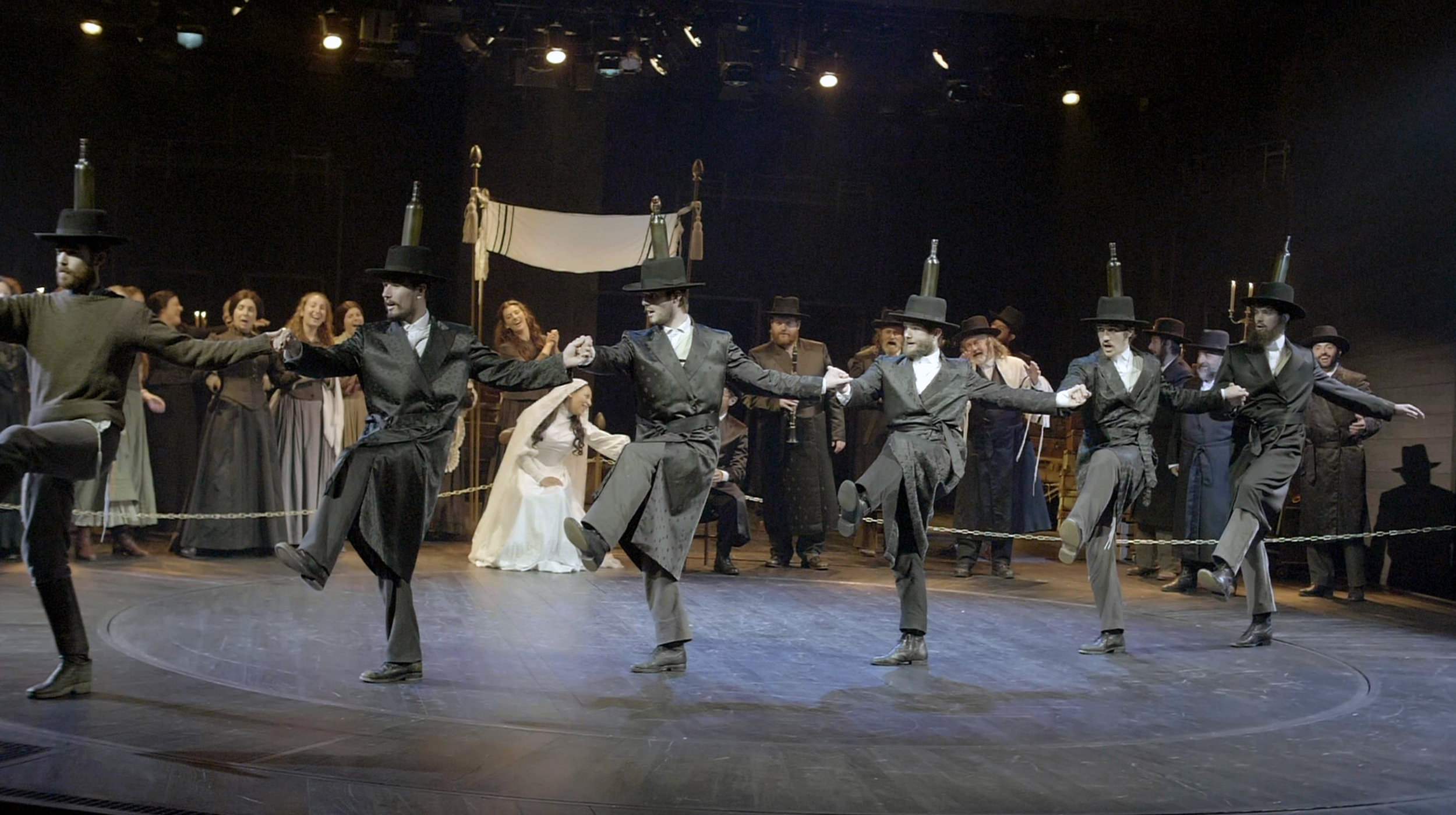 """The cast of a production of """"Fiddler on the Roof"""" at Chichester Festival Theatre in the UK perform the famous bottle dance, in a scene from the documentary """"Fiddler: A Miracle o Miracles."""" (Photo by Chichester Festival Theatre, courtesy of Roadside Attractions and Samuel Goldwyn Films.)"""