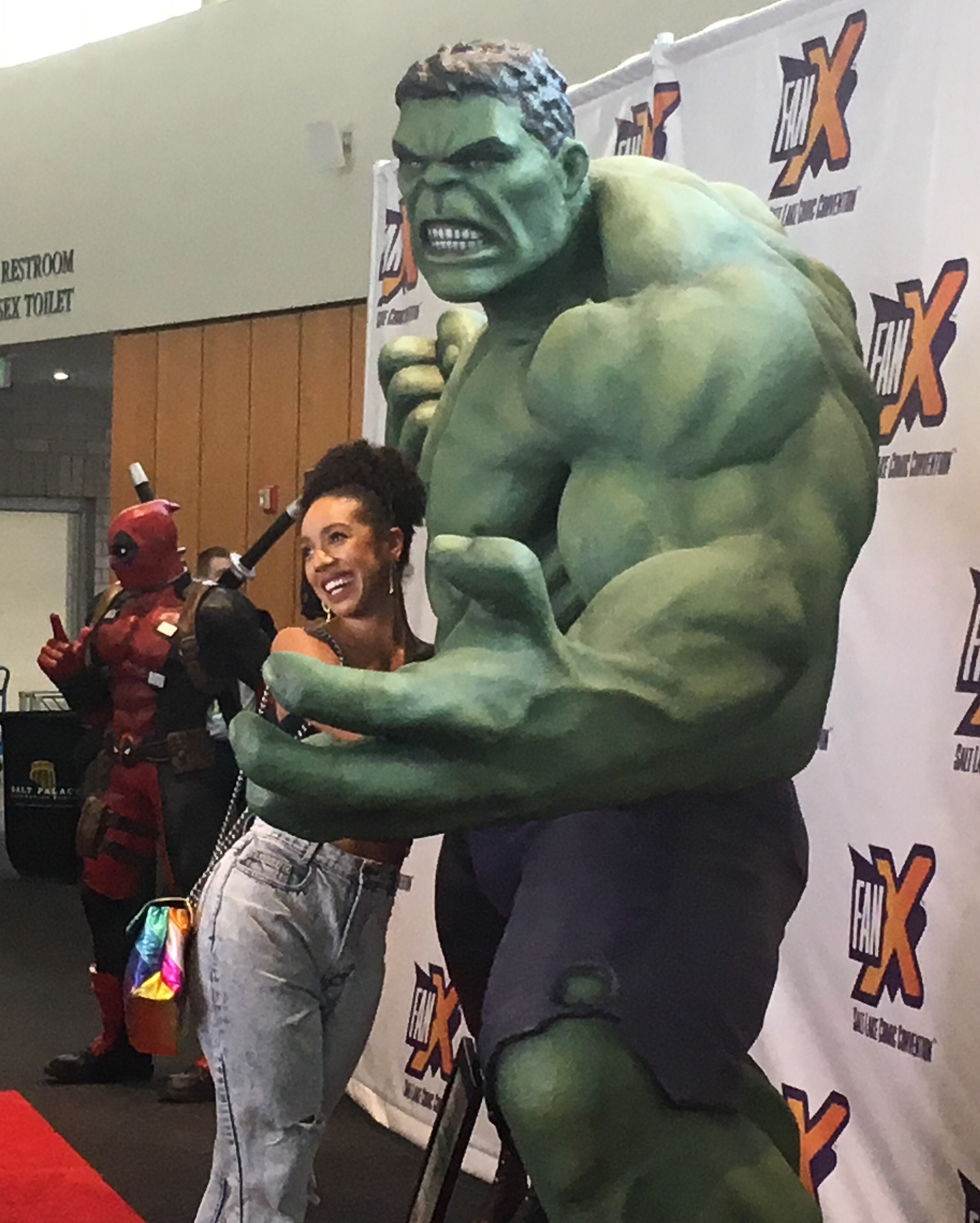 "Pearl Mackie, who played the companion Bill on ""Doctor Who,"" poses with a giant Hulk statue on the red carpet of FanX Salt Lake Comic Convention on Thursday, Sept. 5, 2019. (Photo by Sean P. Means  