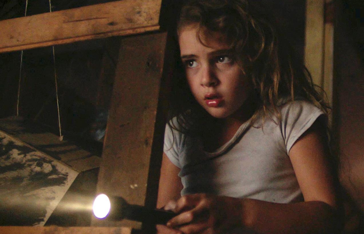 """Chloe (Lexy Kolker) hears something terrifying, in a scene from the horror thriller """"Freaks."""" (Photo courtesy of Well Go USA.)"""