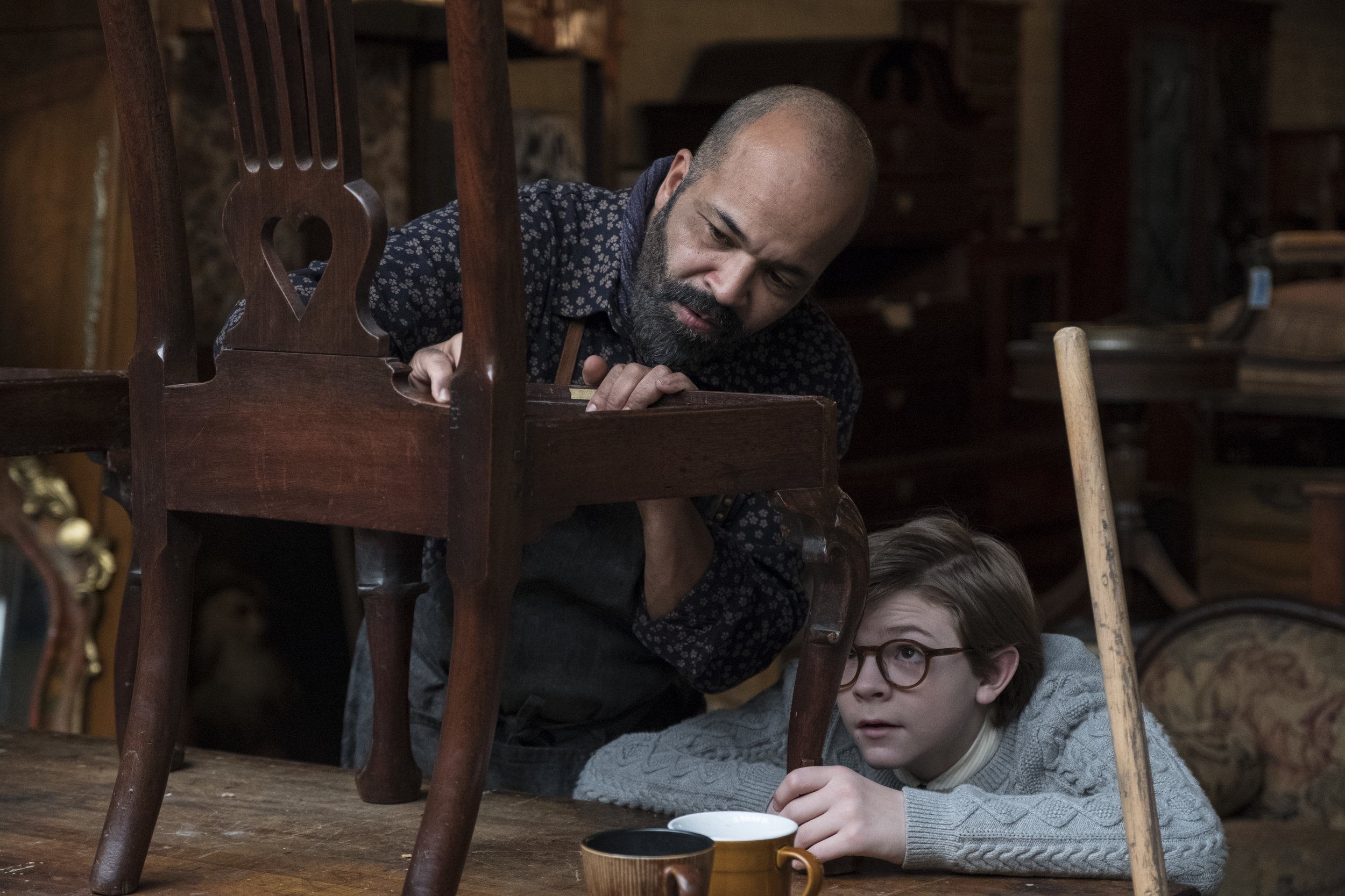 "Hobie (Jeffrey Wright, left) shows young Theo (Oakes Fegley) the finer points of antique restoration, in a scene from the drama ""The Goldfinch."" (Photo by Macall Polay, courtesy of Warner Bros. Pictures.)"