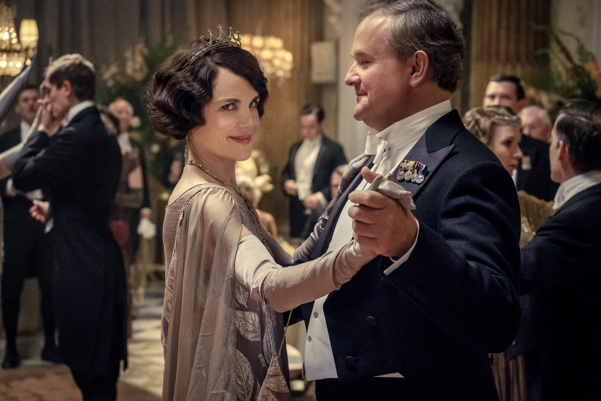 """Lady Grantham (Elizabeth McGovern, left) and Lord Grantham (Hugh Bonneville) dance at a royal ball, in a scene from """"Downton Abbey."""" (Photo by Jaap Buitendijk, courtesy of Focus Features.)"""