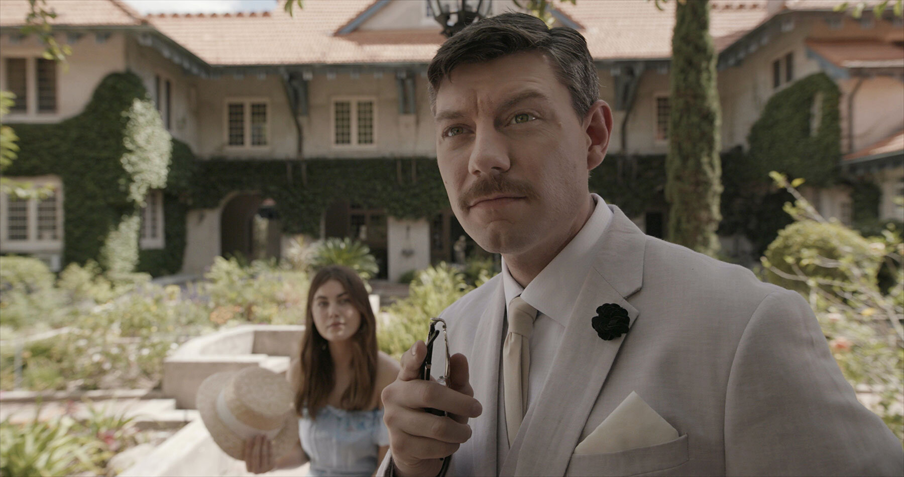 "Emma (Charlotte Best, left) finds herself charmed by Dr. Samuel Sussican (Patrick Fugit), in the road movie-turned-horror thriller ""A Name Without a Place,"" written and directed by Kenny Riches. (Photo courtesy of Dualist.)"