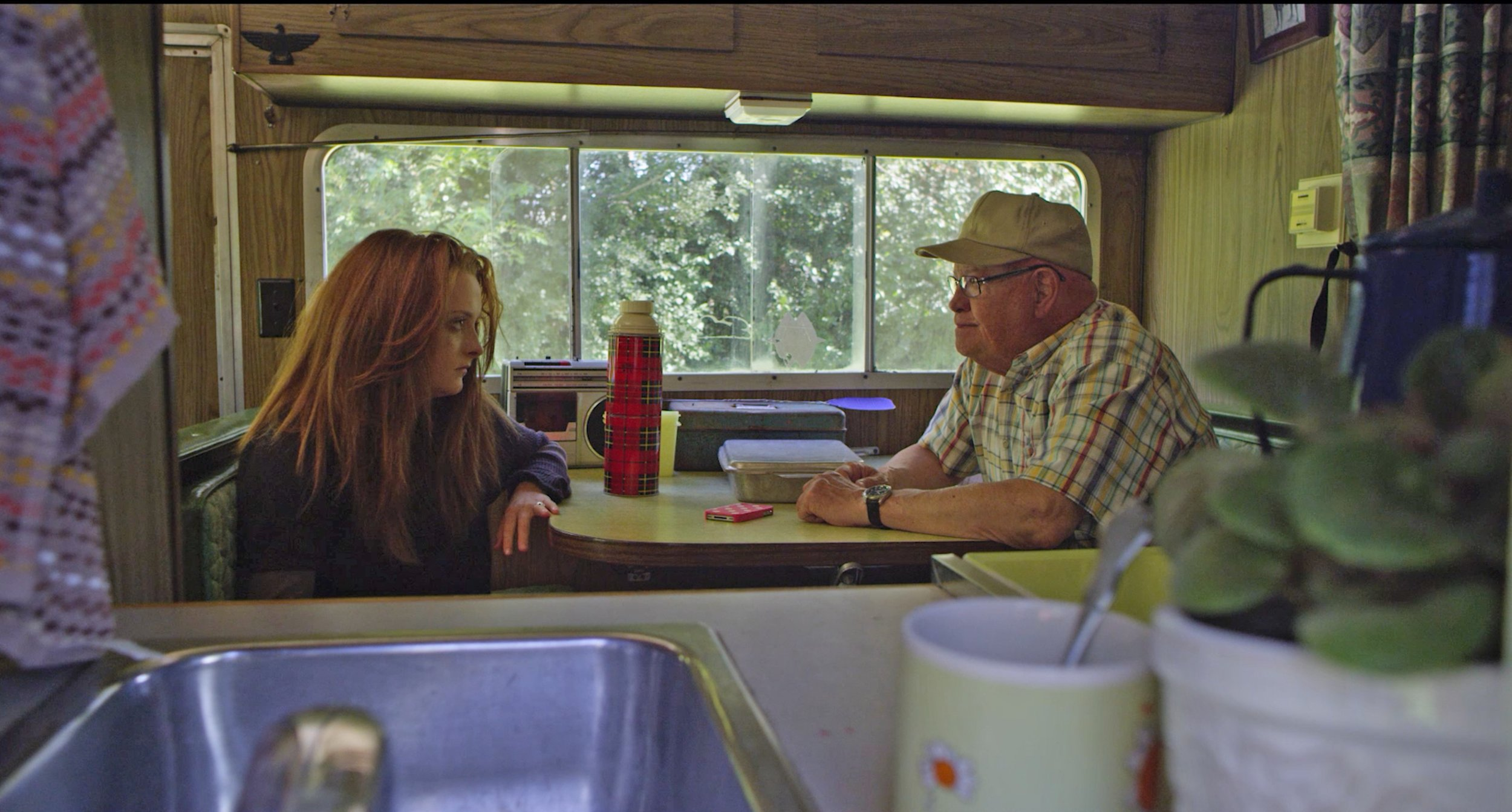 """Retired farmer Hap Anderson (Barry Corbin, right) and his college-graduate granddaughter Ashley (Mackinlee Waddell) argue during their road trip, in the comedy-drama """"Farmer of the Year."""" (Photo courtesy Yellow House Films.)"""