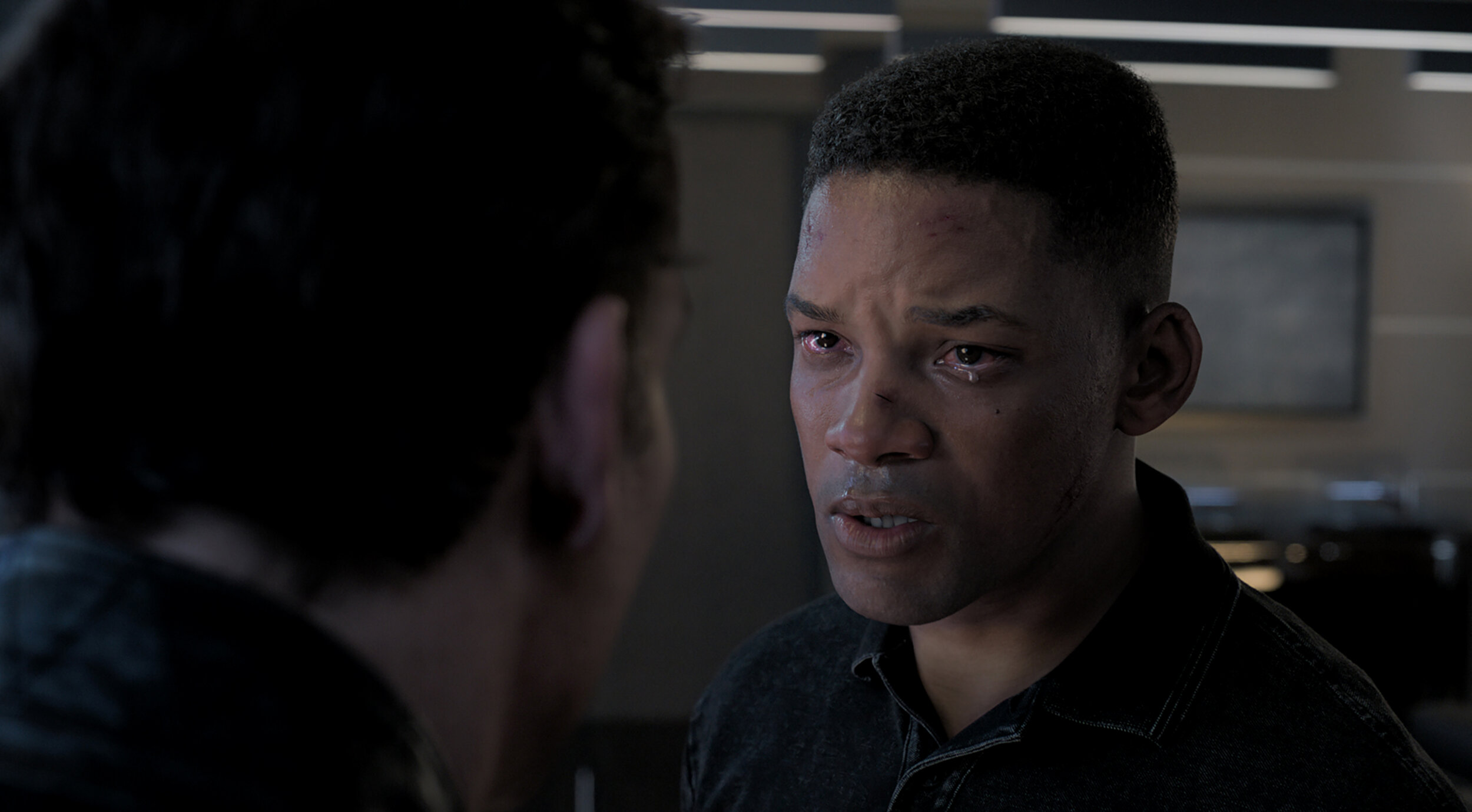 "Young assassin Junior (played by a de-aged Will Smith) confronts his handler, Clay Verris (Clive Owen), in a scene from Ang Lee's action thriller ""Gemini Man."" (Image courtesy of Paramount Pictures.)"