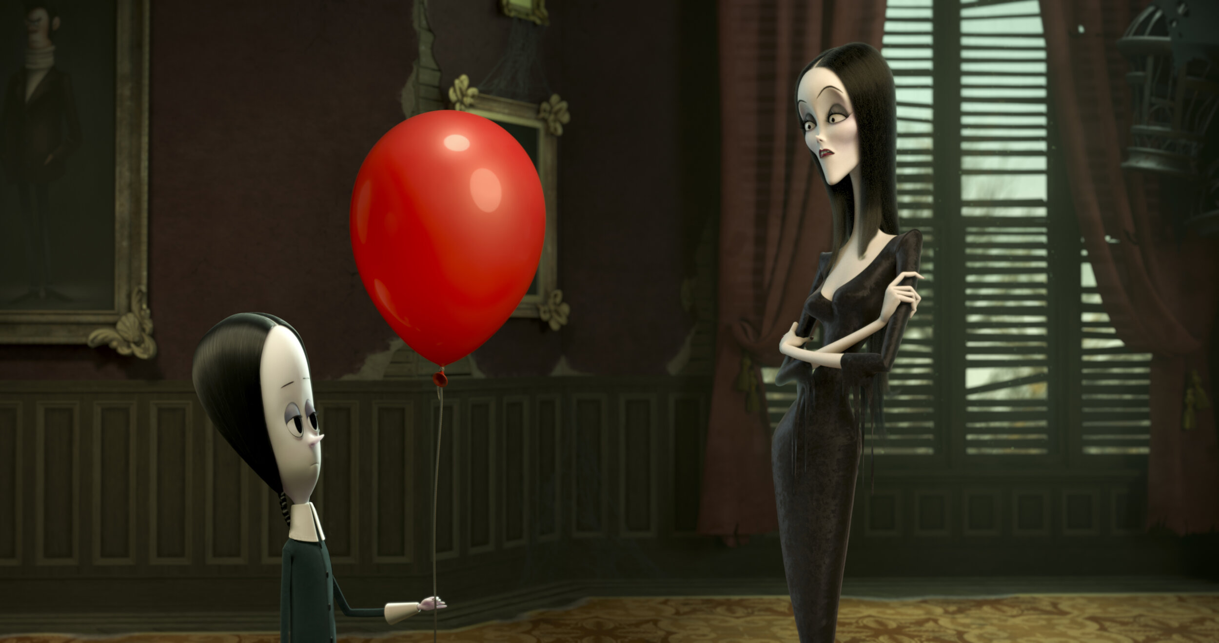 """Wednesday, left (voiced by Chloë Grace Moretz), presents her mother, Morticia (voiced by Charlize Theron), with an odd human artifact, in a scene from the animated """"The Addams Family."""" (Image courtesy MGM Pictures.)"""