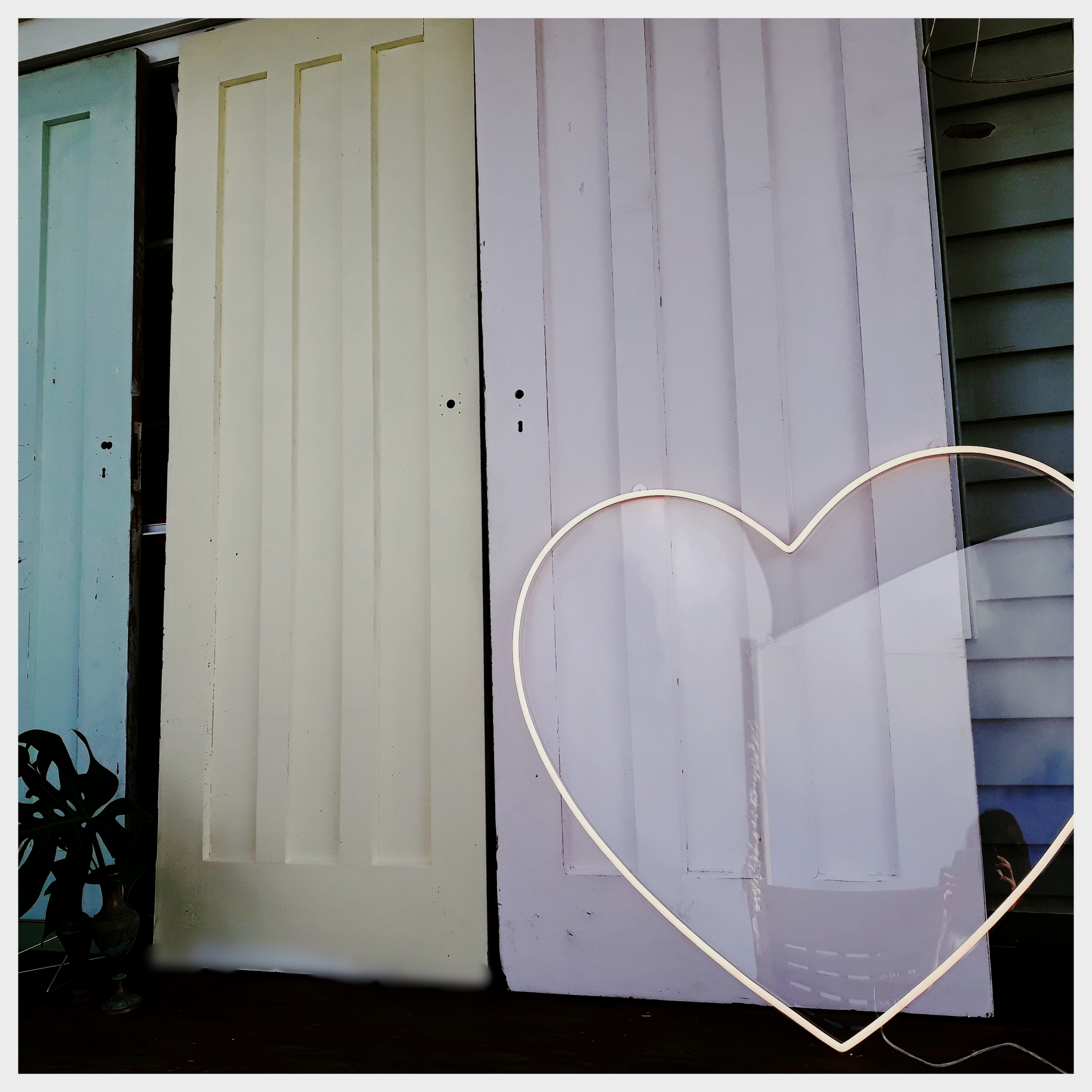 Say vintage with a heart - Vintage and Style's Neon Heart and Vintage Backdrop Doors both available for hire.