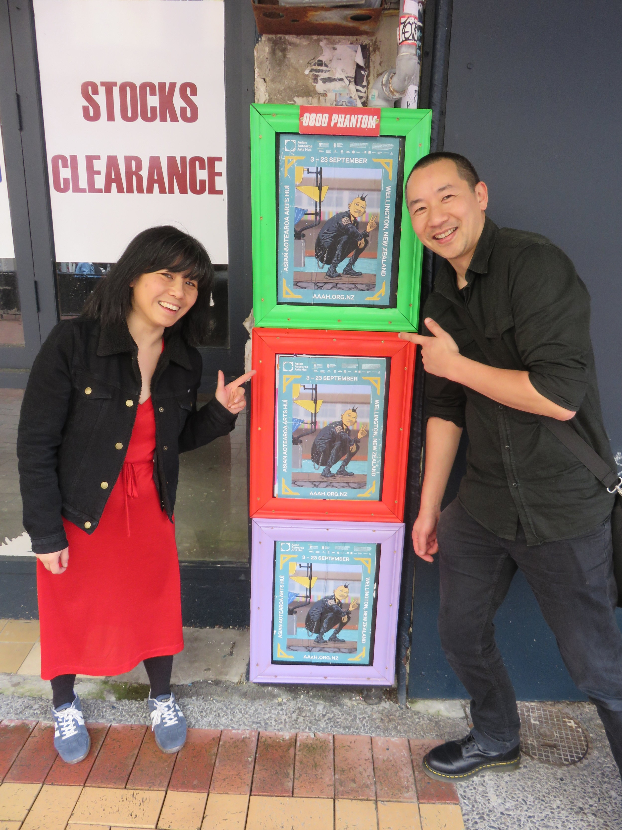 Kerry Ann Lee and Ant Sang with the AAAH2018 Artist Billboard Campaign, 1 - 23 September, Wellington CBD. Photo by Sam Buchanan