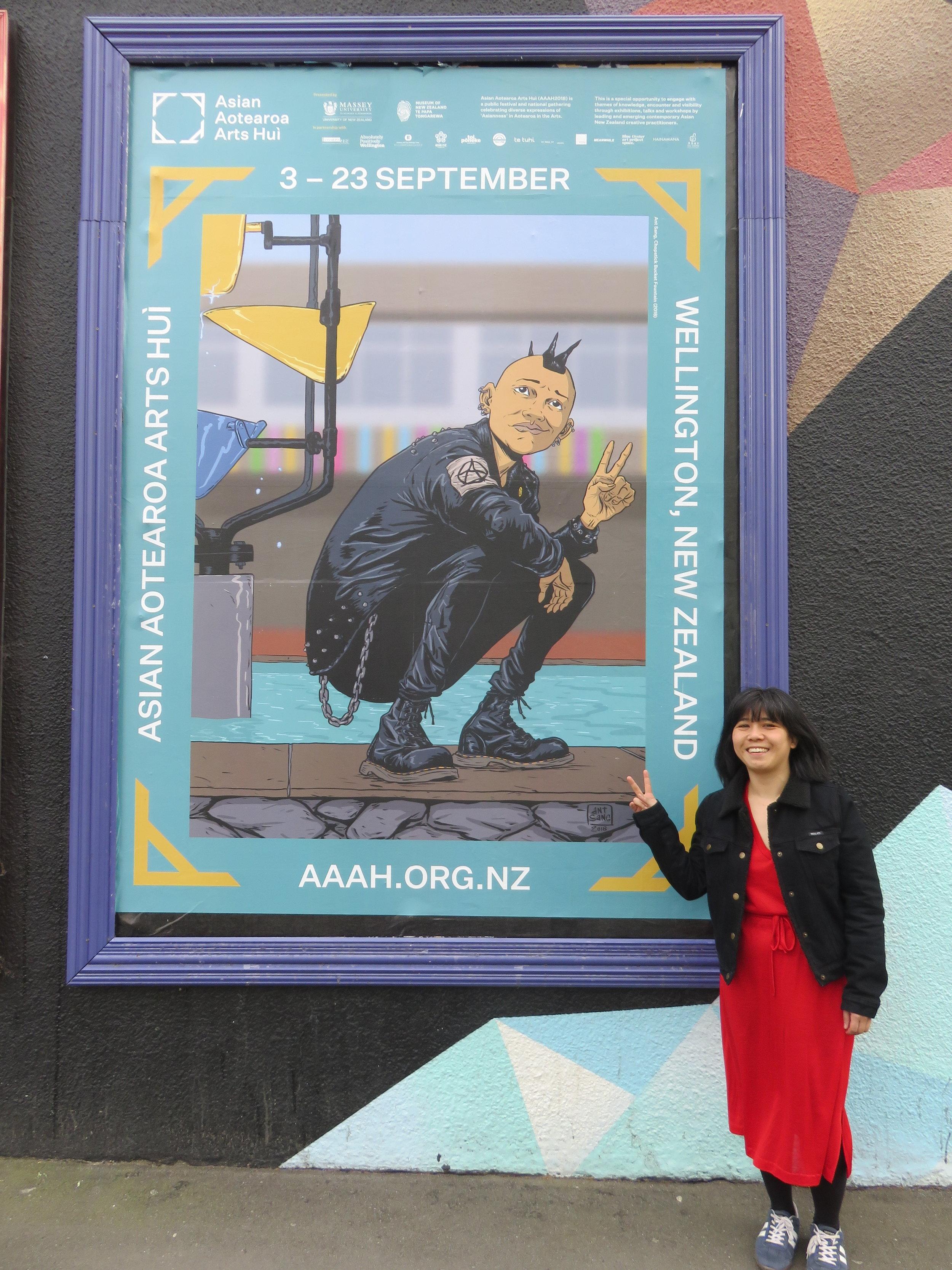 Kerry Ann Lee with the AAAH2018 Artist Billboard Campaign, 1 - 23 September, Wellington CBD. Photo by Sam Buchanan