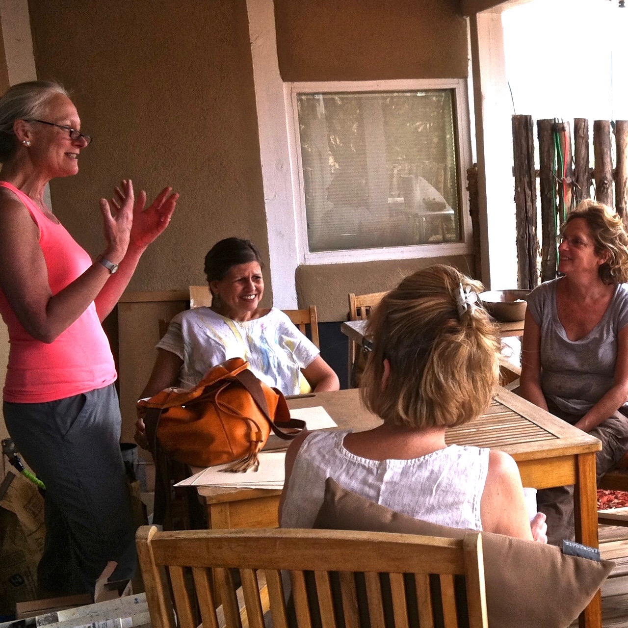 students collaborate and laugh while away at a workshop in New Mexico | Artist Mastery Guide, Marianne Mitchell