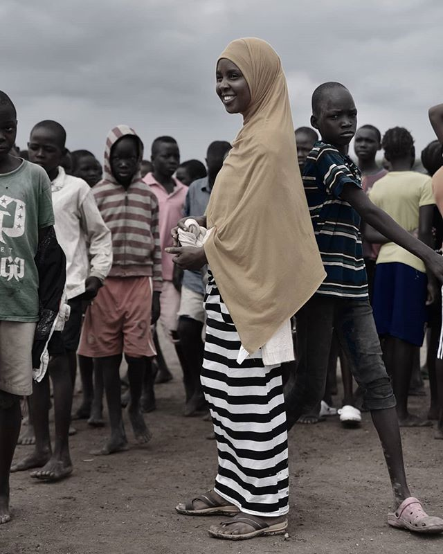A young woman organizes a group of boys for a football training session. Sports is a valuable tool for the positive engagement of refugees in Kenya's North East. #storieslast