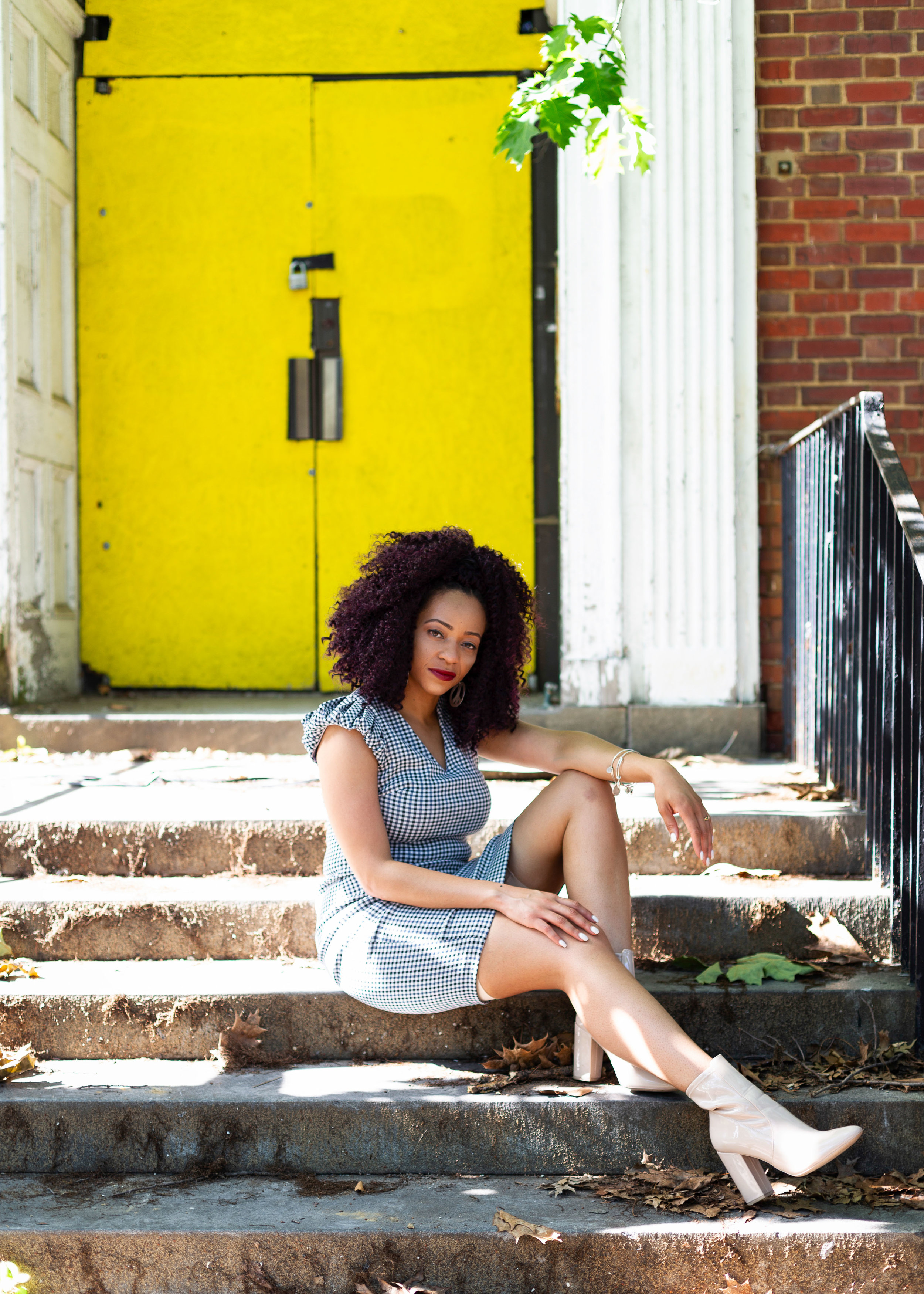 Black Girl Sitting on Steps On Yellow