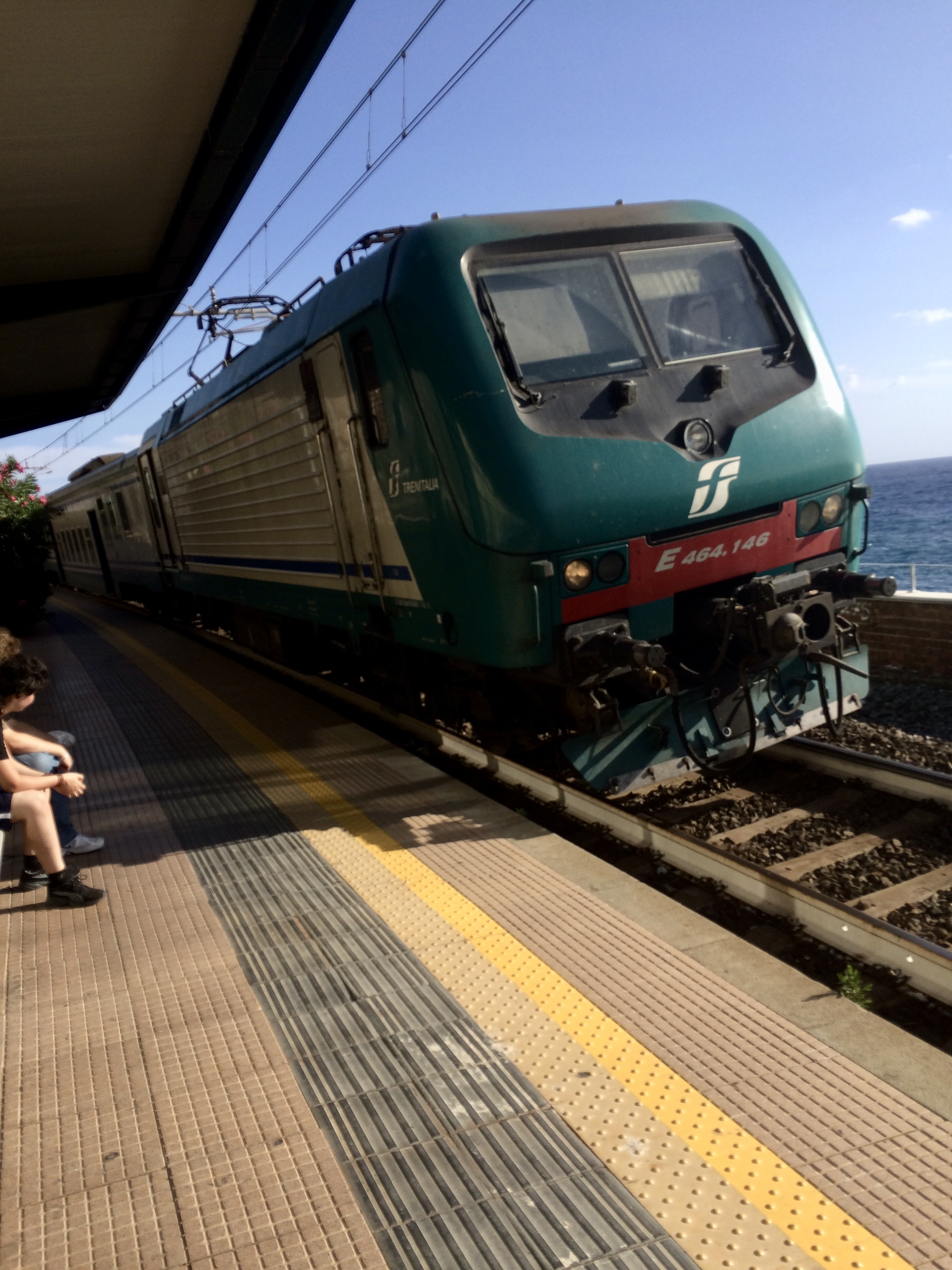 Waiting for the train with friends, in Italy, 2015.