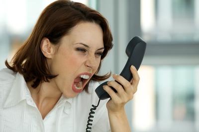 woman screaming into phone.jpg