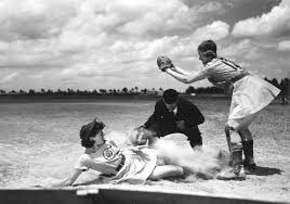 woman baseball player sliding into home plate old fashioned.jpg