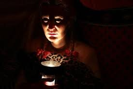 woman with flashlight under chin spooky.jpg