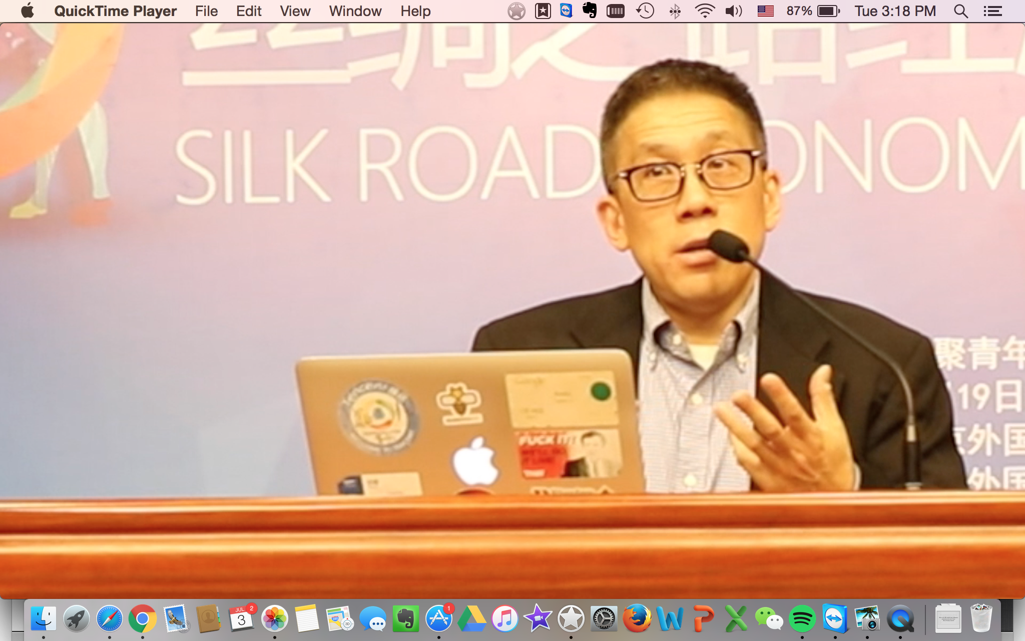 Andy Mok at conference.png