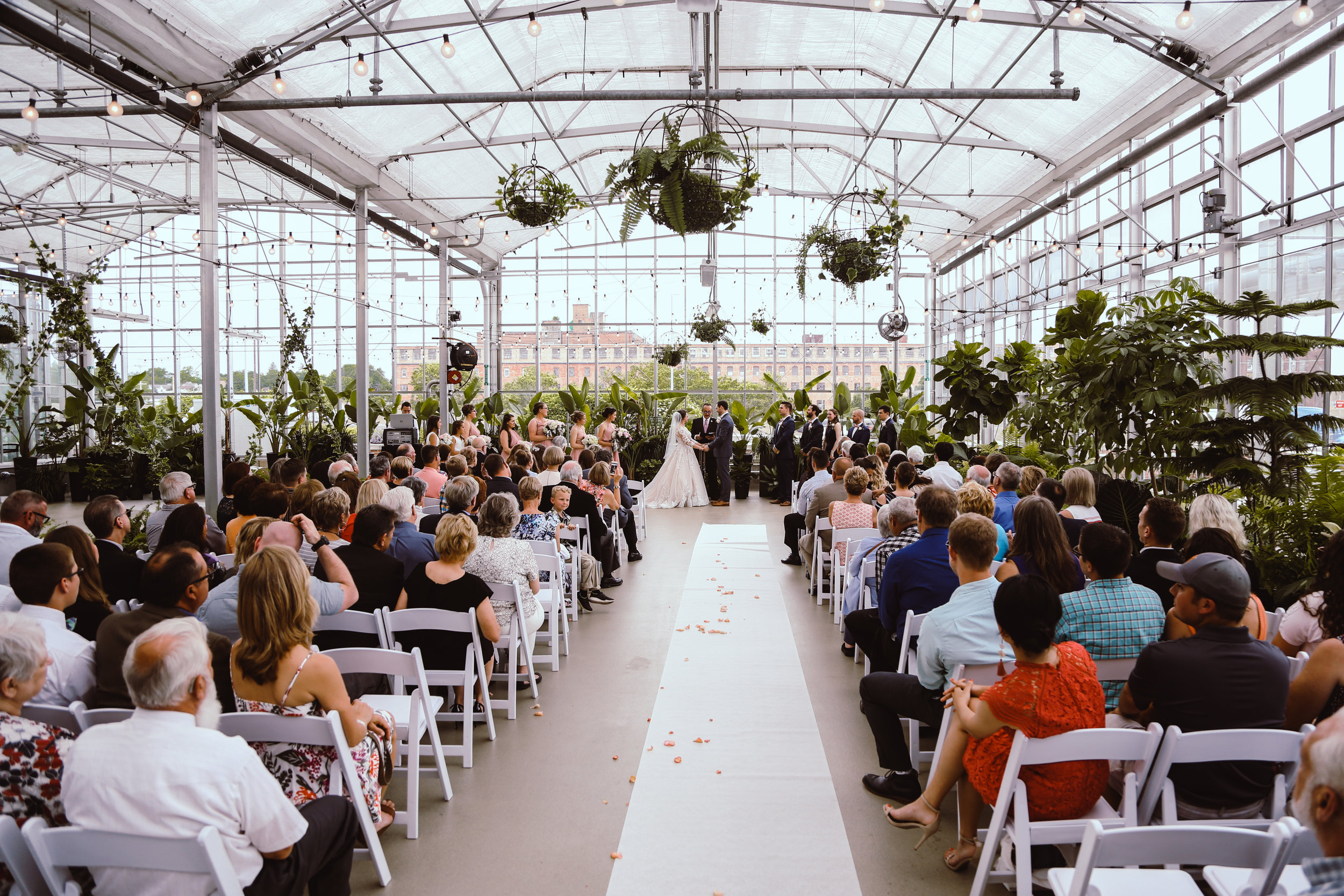 If you can't tell from my images, I love natural light. So naturally, creating a gorgeous ceremony within a greenhouse is one of my favorite ideas. It creates an opportunity for natural light and a sense of life while still keeping temperatures regulated, easy access to elderly guests, and is not weather dependent.