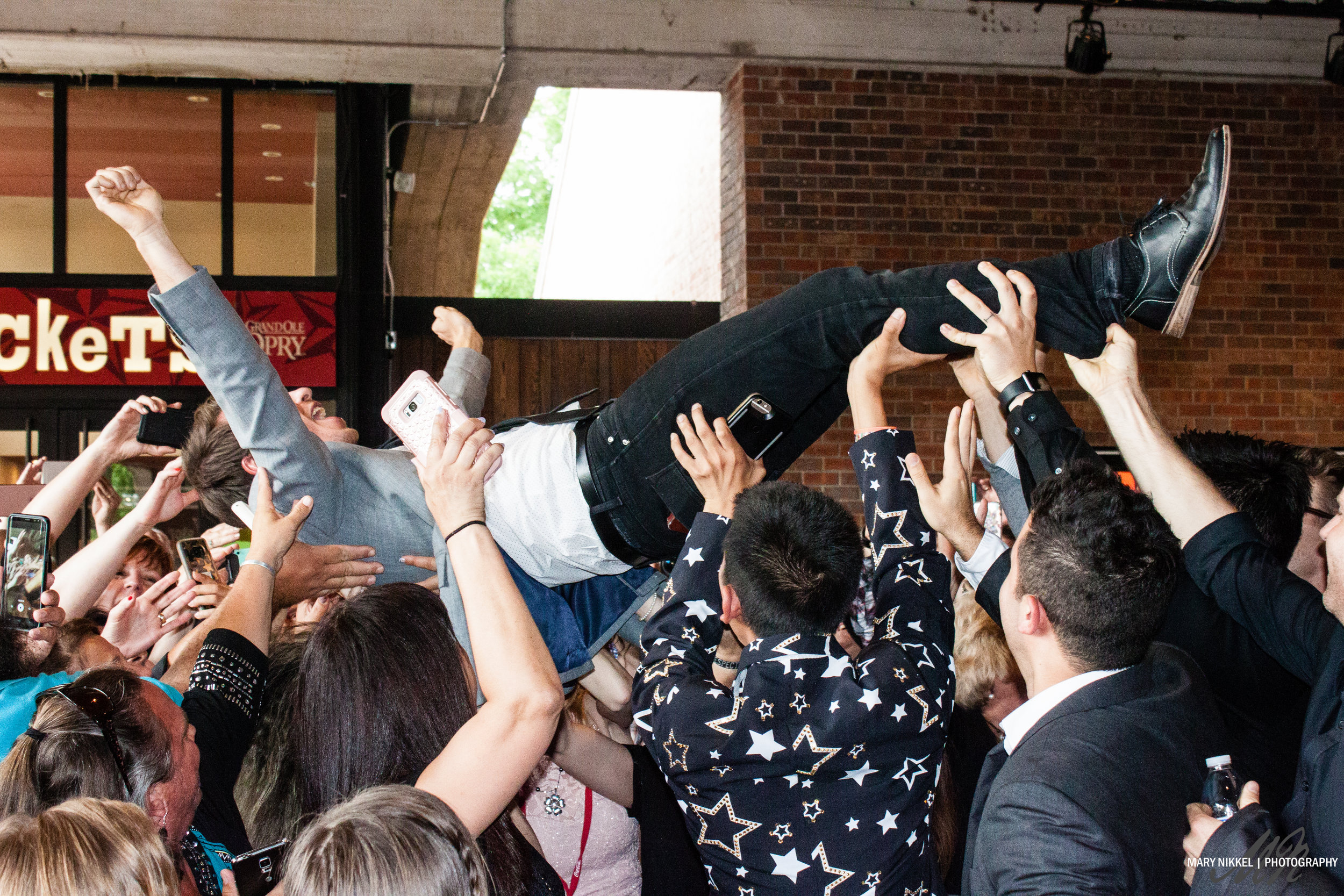 Mike Donehey of Tenth Avenue North crowd surfs at the KLOVE Fan Awards 2017 in front of the Grand Ole Opry; shared on Mike Donehey's Instagram to 48k followers.
