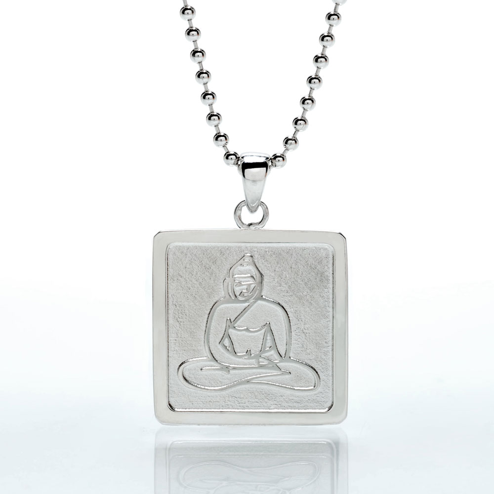 Design #1 - The first iteration was a sterling silver, square framed pendant necklace. This rendition of Buddha used the exact same line work as the original painting.