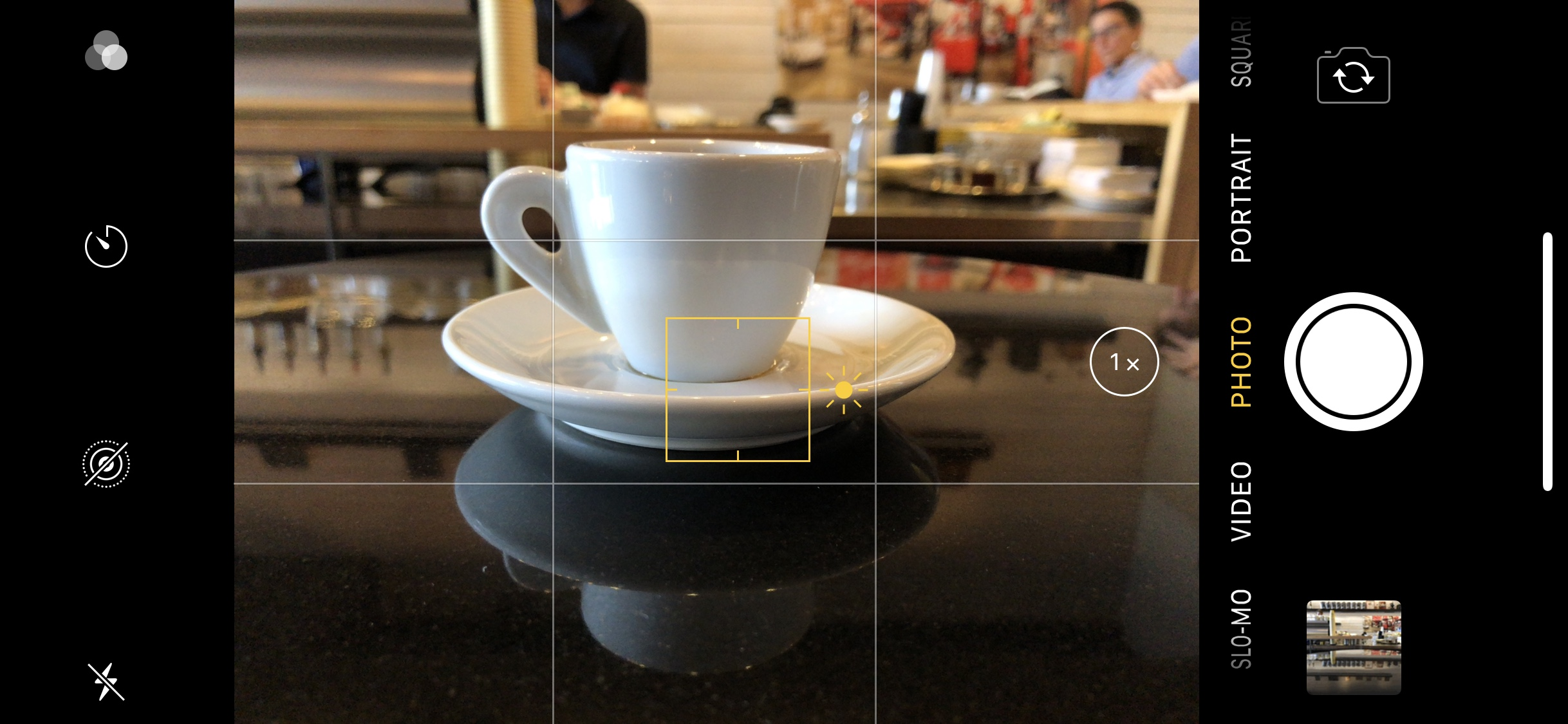 Tap to focus reveals an exposure compensation control at right.