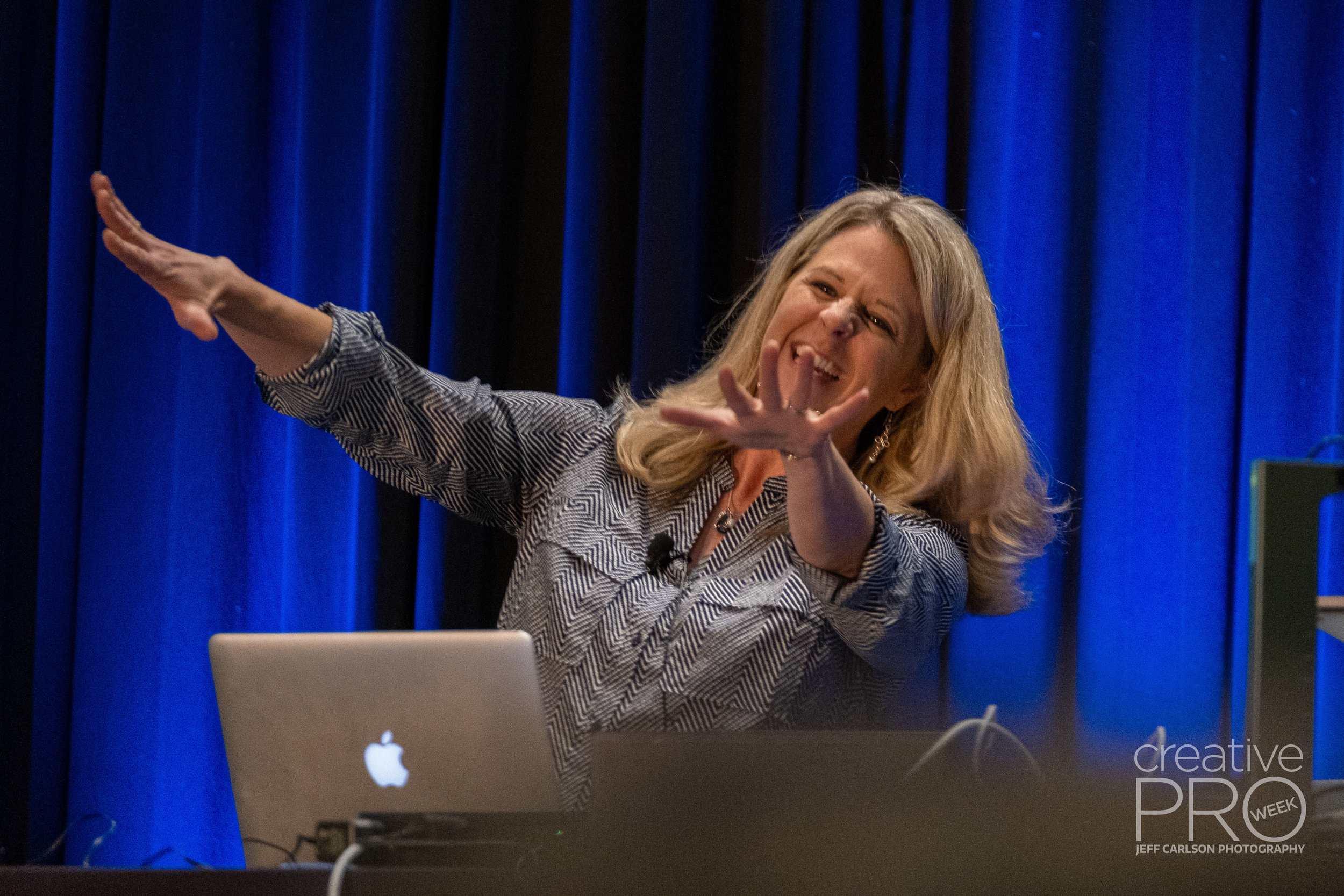 Speaker Laurie Ruhlin at CreativePro Week 2019  Camera: Fujifilm X-T3 Shutter speed: 1/125 sec Aperture: f/2.8 ISO: 3200 Lens: Fujifilm XF 50-140mm f/2.8 LM OIS WR Photo: Jeff Carlson, courtesy of CreativePro Week