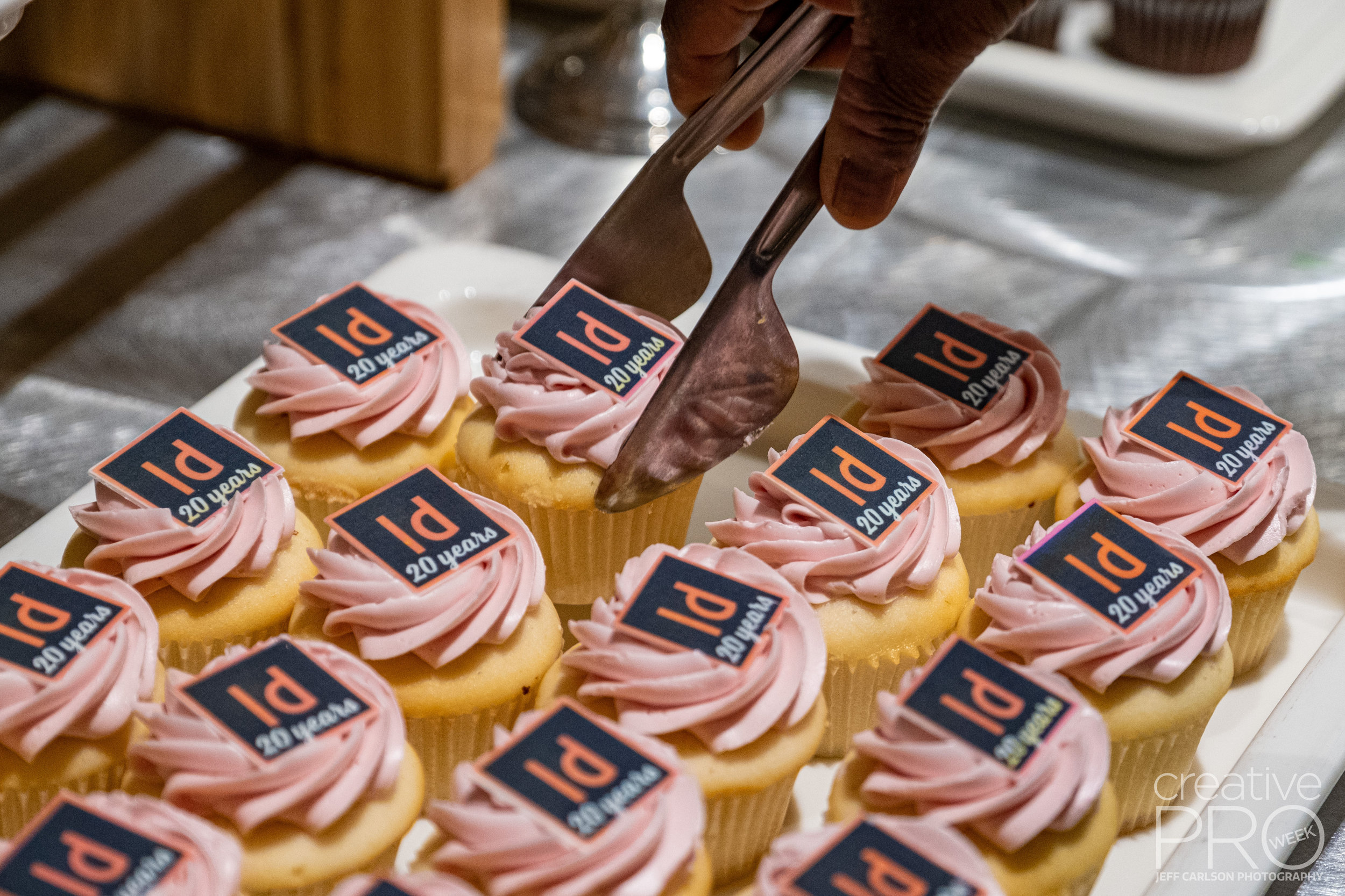 InDesign 20th Anniversary Cupcakes at CreativePro Week 2019  Camera: Fujifilm X-T3 Shutter speed: 1/200 sec Aperture: f/2.8 ISO: 1600 Lens: Fujifilm XF 16-55mm f/2.8 LM WR Photo: Jeff Carlson, courtesy of CreativePro Week