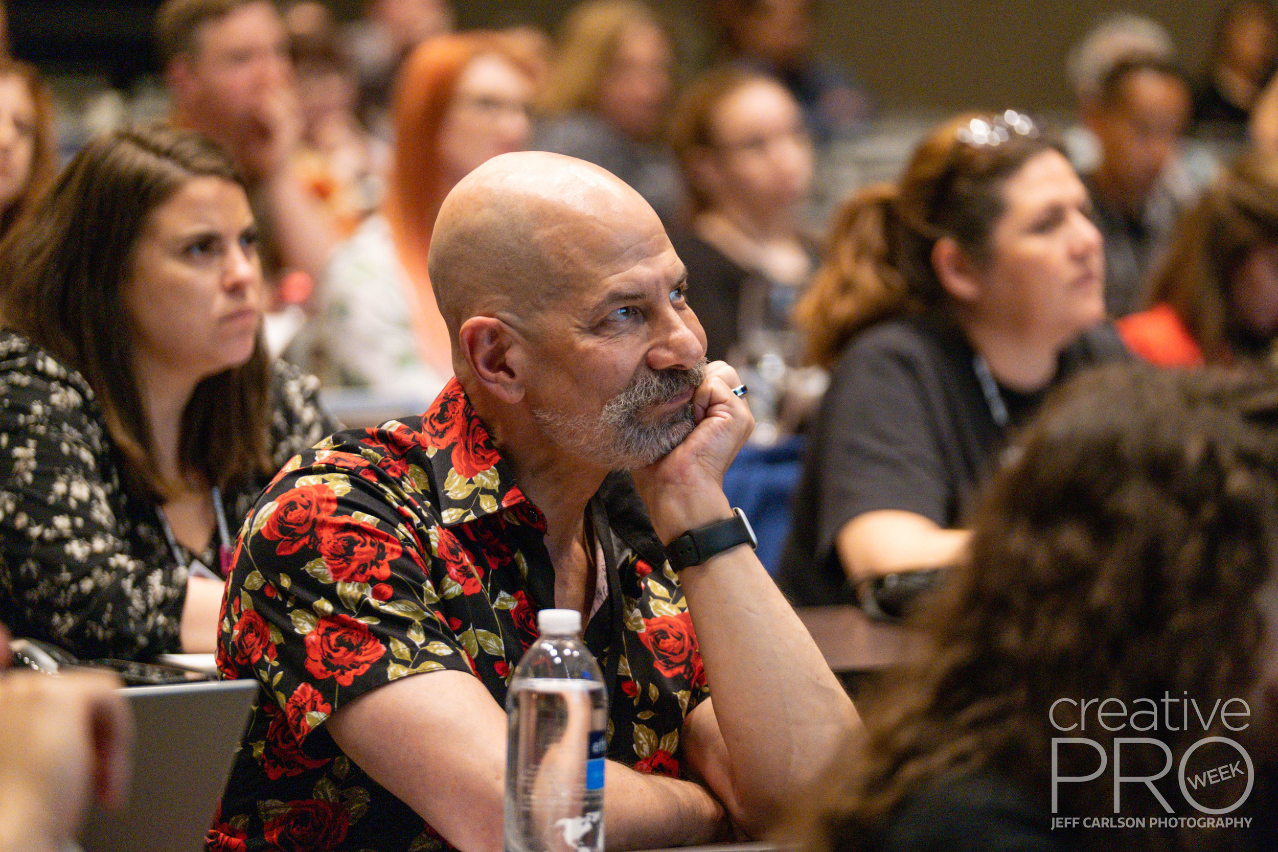 A rapt attendee at CreativePro Week 2019  Camera: Fujifilm X-T3 Shutter speed: 1/160 sec Aperture: f/2.8 ISO: 6400 Lens: Fujifilm XF 50-140mm f/2.8 LM OIS WR Photo: Jeff Carlson, courtesy of CreativePro Week
