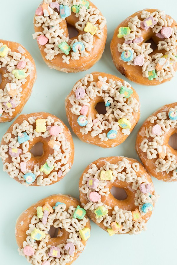 Lucky Charms Donuts: an easy treat you can make with store-bought donuts for St. Patrick's Day at Studio DIY | featured at Didn't I Just Feed You, a food podcast for parents