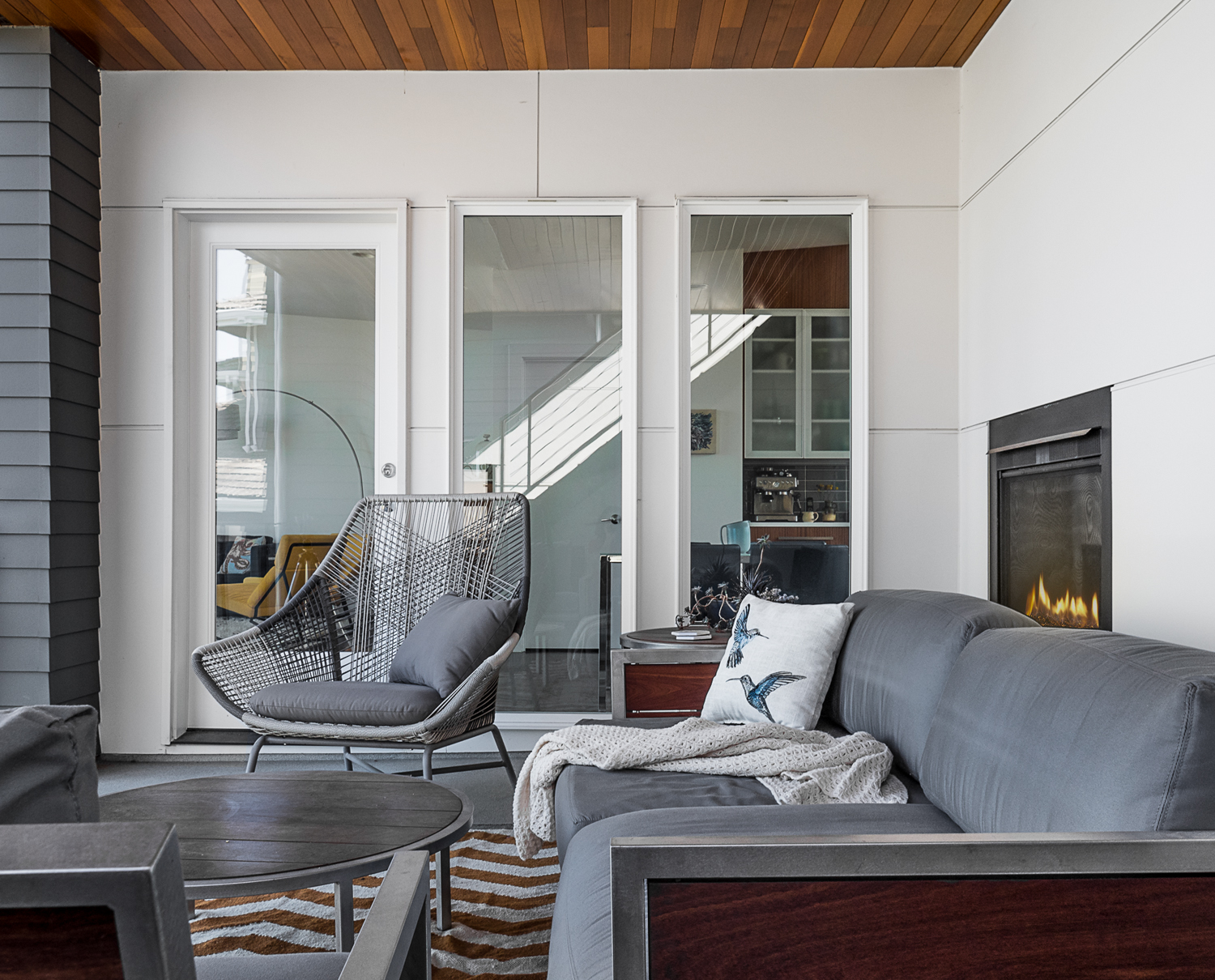 modern cpvered patio with furniture and fireplace