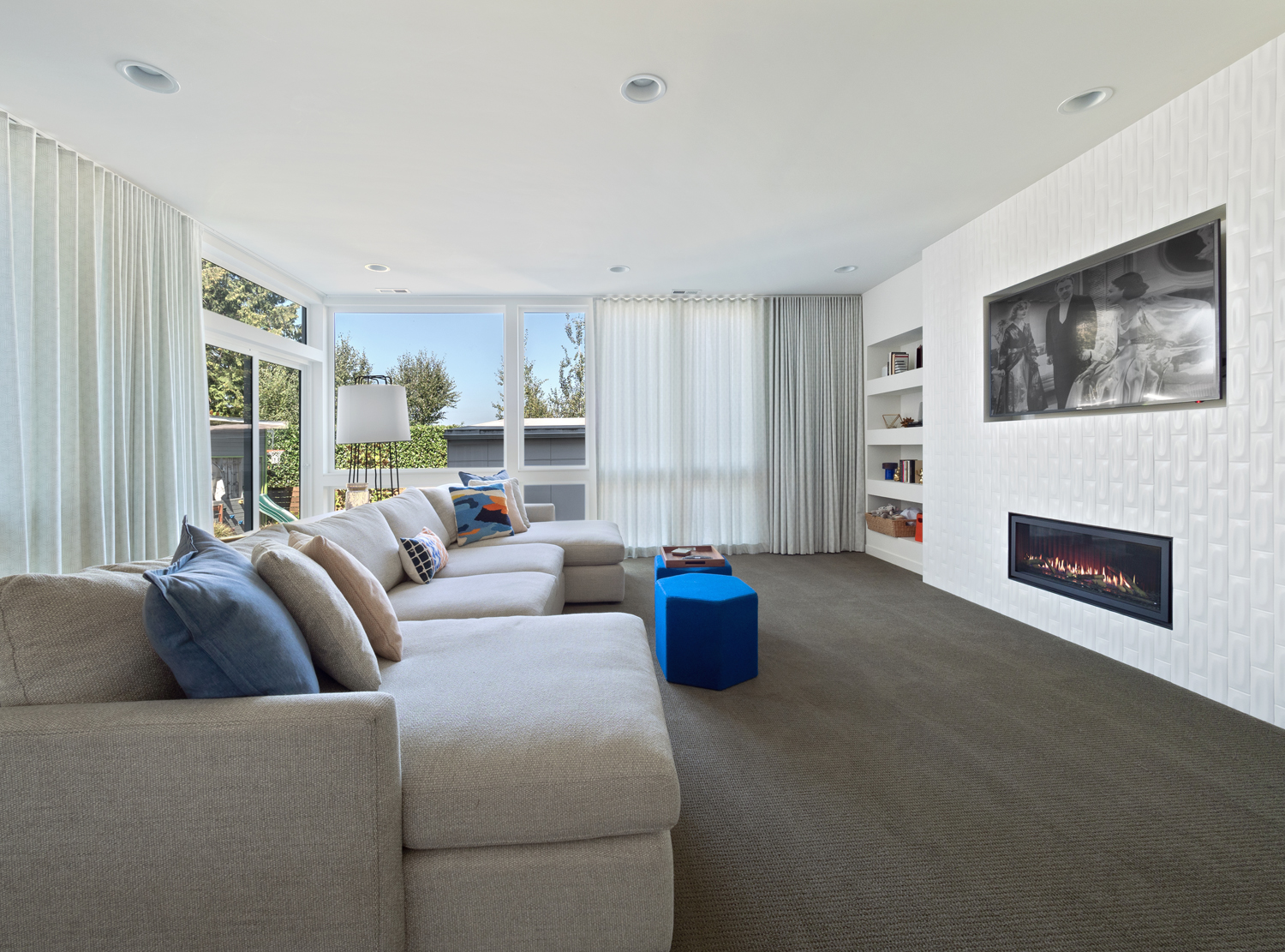 modern family room with TV and fireplace