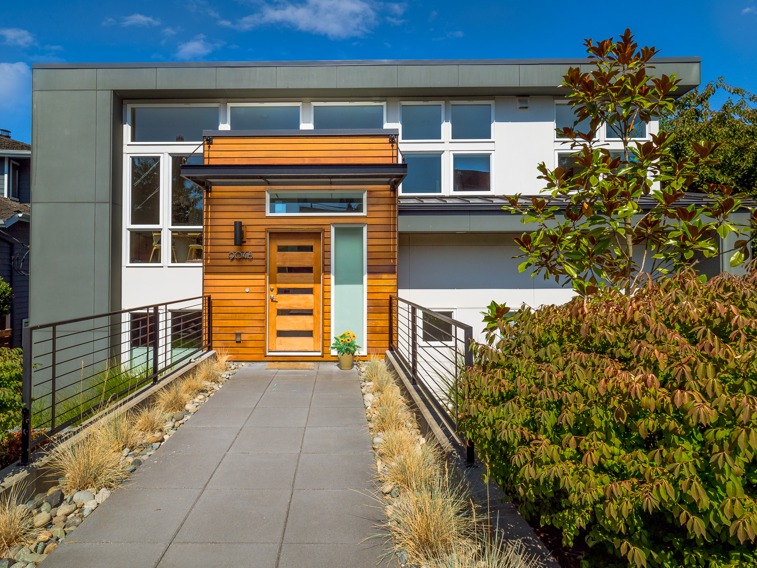modern home exterior with wood accent
