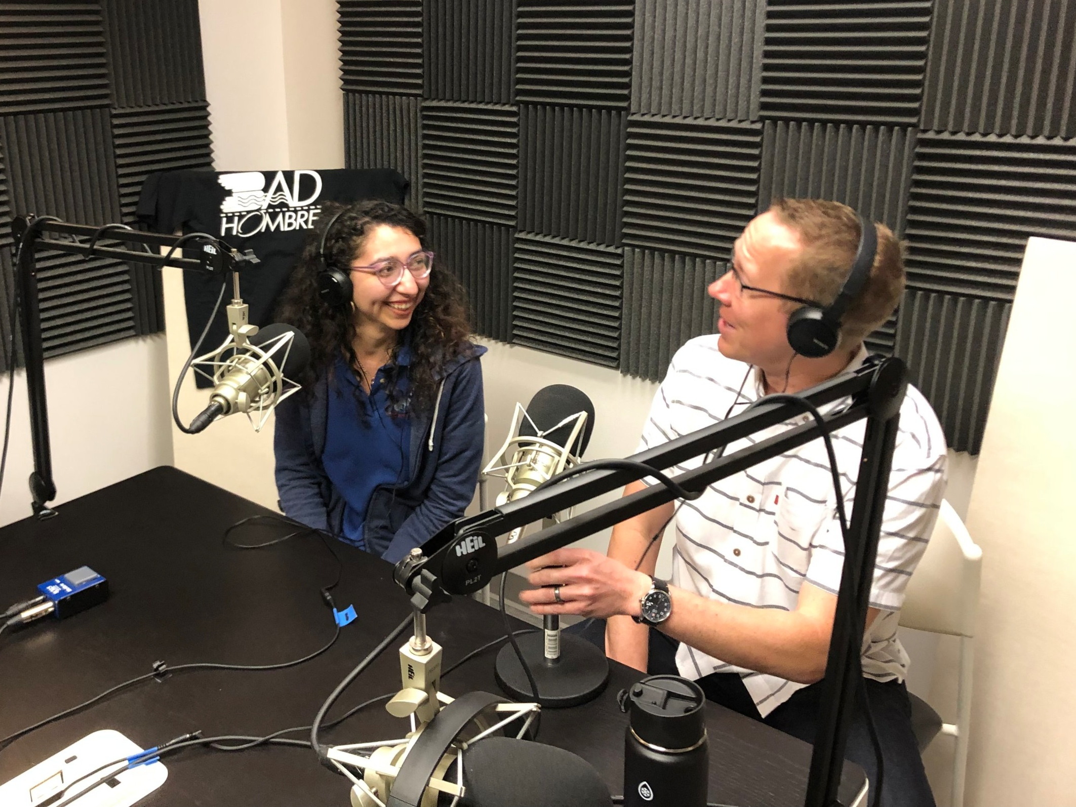 Analaura and Greg in the podcast studio