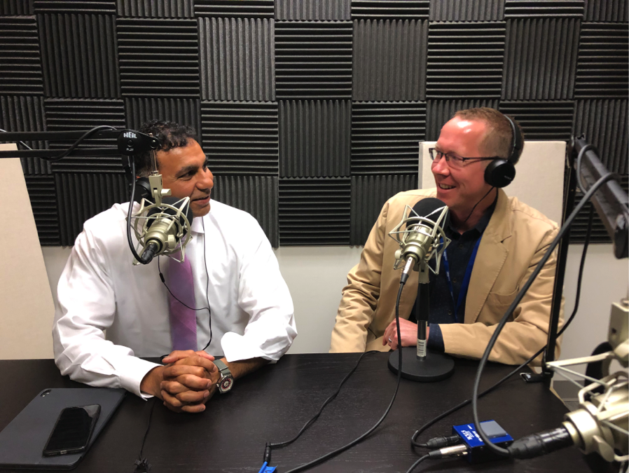 Dr. Patel, CEO of Neighborhood Healthcare, and host Greg Anglea, CEO of Interfaith Community Services, in the studio.