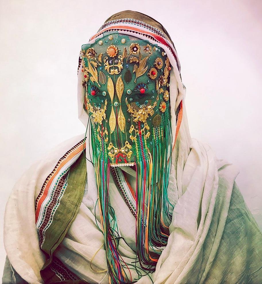 Musician Nhor selects the  masks  of Norwegian  artist  Magnhild Kennedy