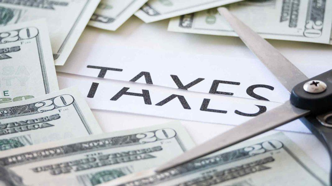 cut-taxes-bills-scissors-1068x600.jpg