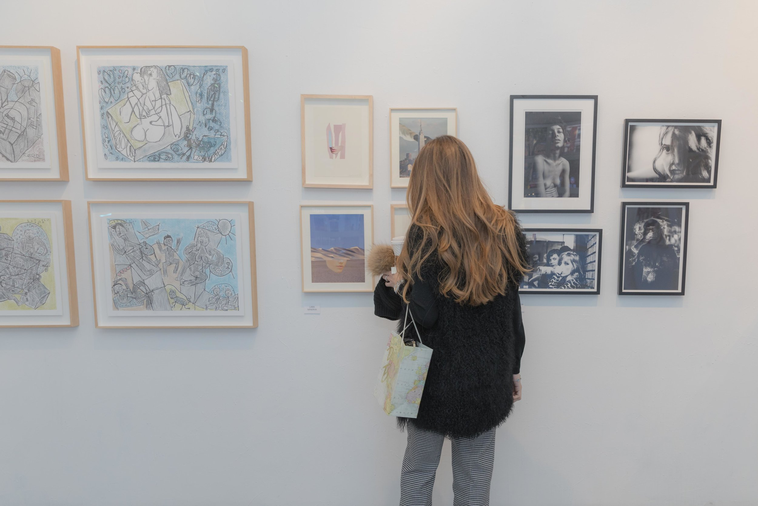 Art influencer and NYC tour guide Patricia de Picciotto admiring artwork by Ygal Gbay, Lara Minerva, and Evelyn Sosa Rojas (left to right)