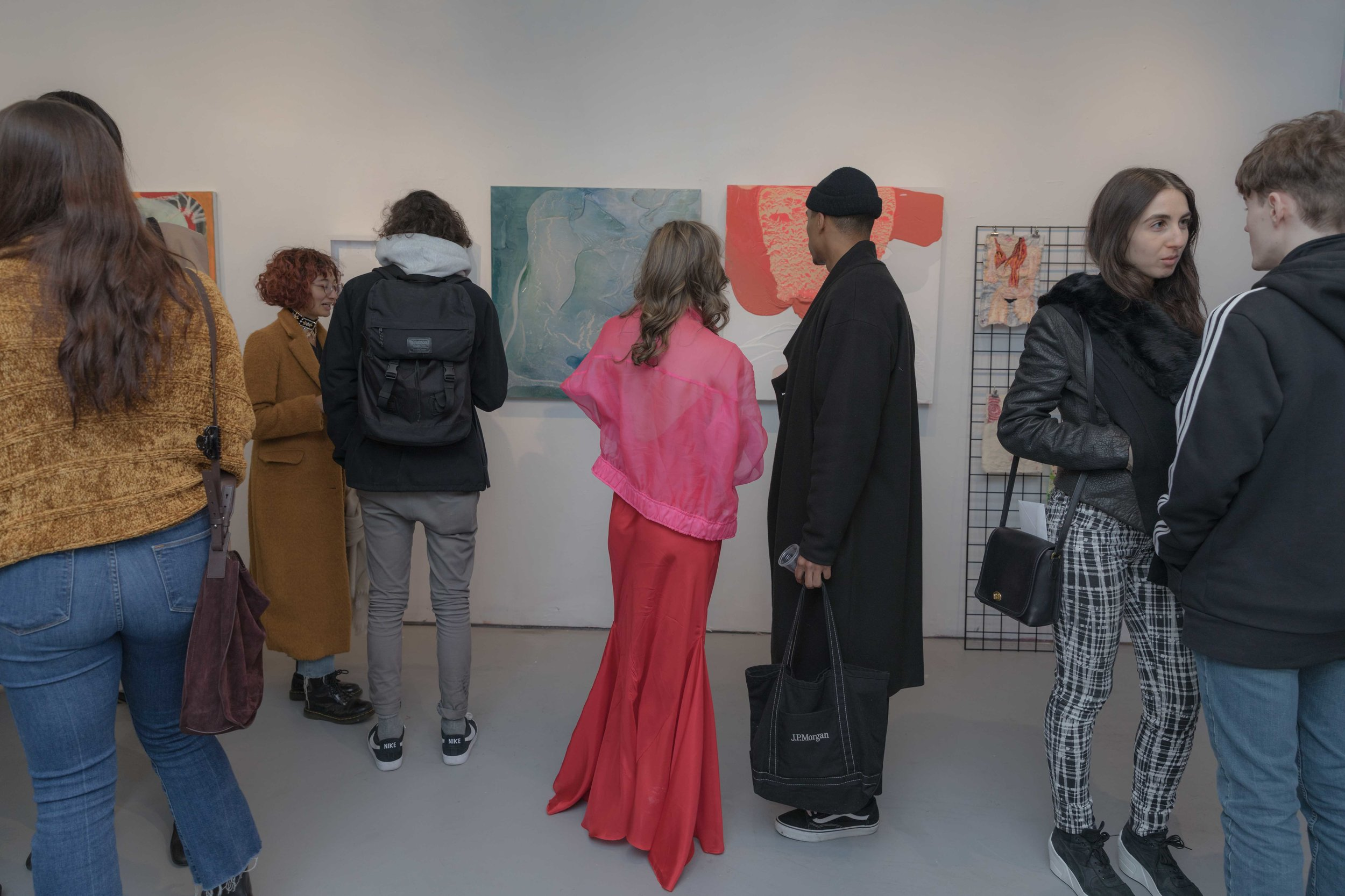 Gallery founder Beckie Warren and collector eyeing work by abstract artist Renee Phillips
